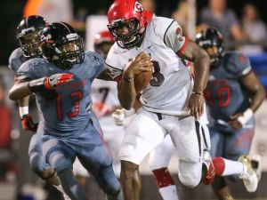 Clinton's Cam Akers makes a run in a game against Brandon. (Photo: Keith Warren/For The Clarion-Ledger)