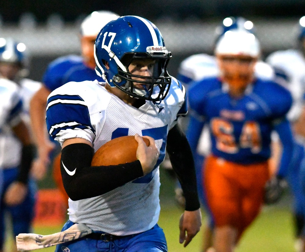 North Harrison's Skyler Wetzel (17) is chased by Silver Creek defenders during the first half of their game, Friday, Sep. 30, 2016 in Sellersburg In. Wetzel scored a touchdown on the play. (Timothy D. Easley/Special to the C-J)
