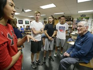 Coach Joe Perez talks with his cross-country athletes before they head out for a long run during practice on Sept. 12 at Appleton East High School. The 82-year-old has coached the Patriots' boys' and girls' cross-country teams for 50 years. (Photo: Dan Powers/USA TODAY NETWORK-Wisconsin)