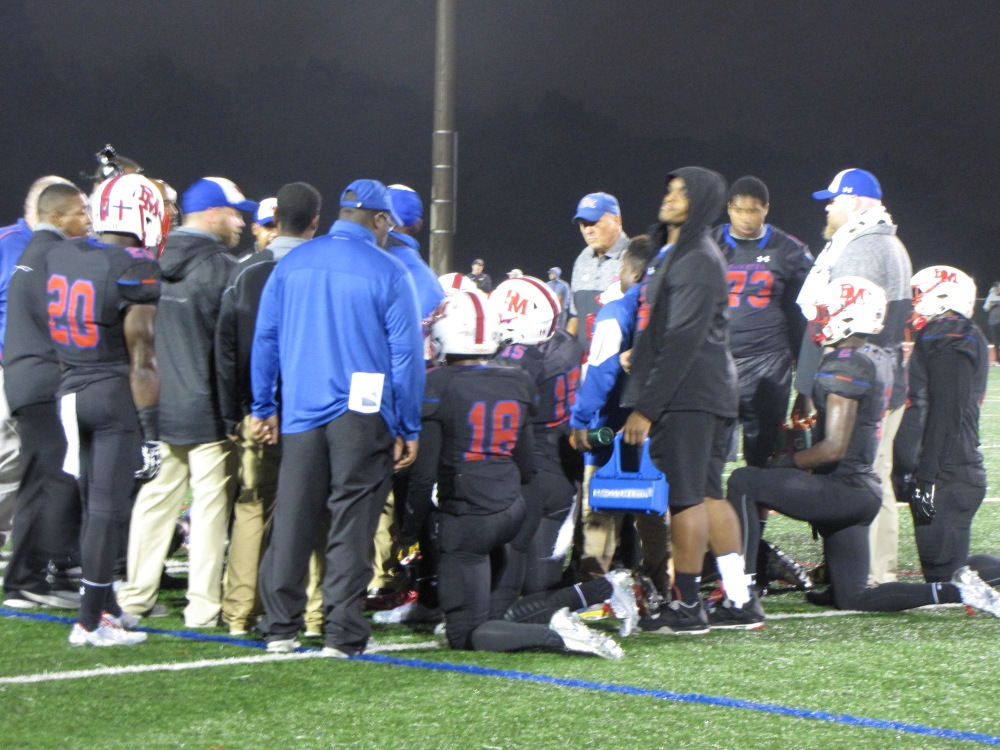 No. 4 DeMatha Catholic (Hyattsville, Md.) huddles after its 14-13 defeat of No. 22 St. John's College (Washington, D.C.) on Friday. (Photo: Jim Halley/USA TODAY Sports).