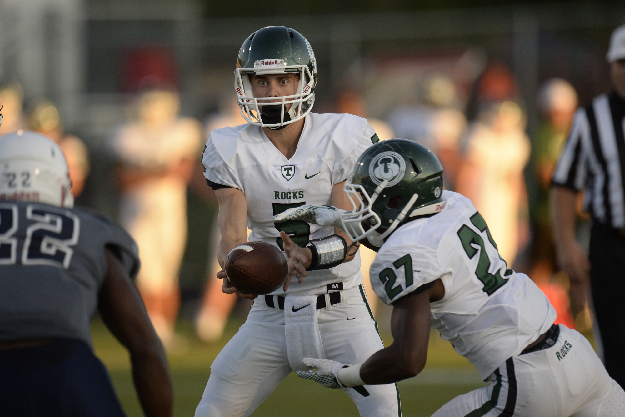 QB Spencer Blackburn hands off the ball to RB Jovan Smith during theTrinity football game against Lafayette in Lexington, KY on Friday, September 3, 2016. Mike Weaver/Special to the CJ
