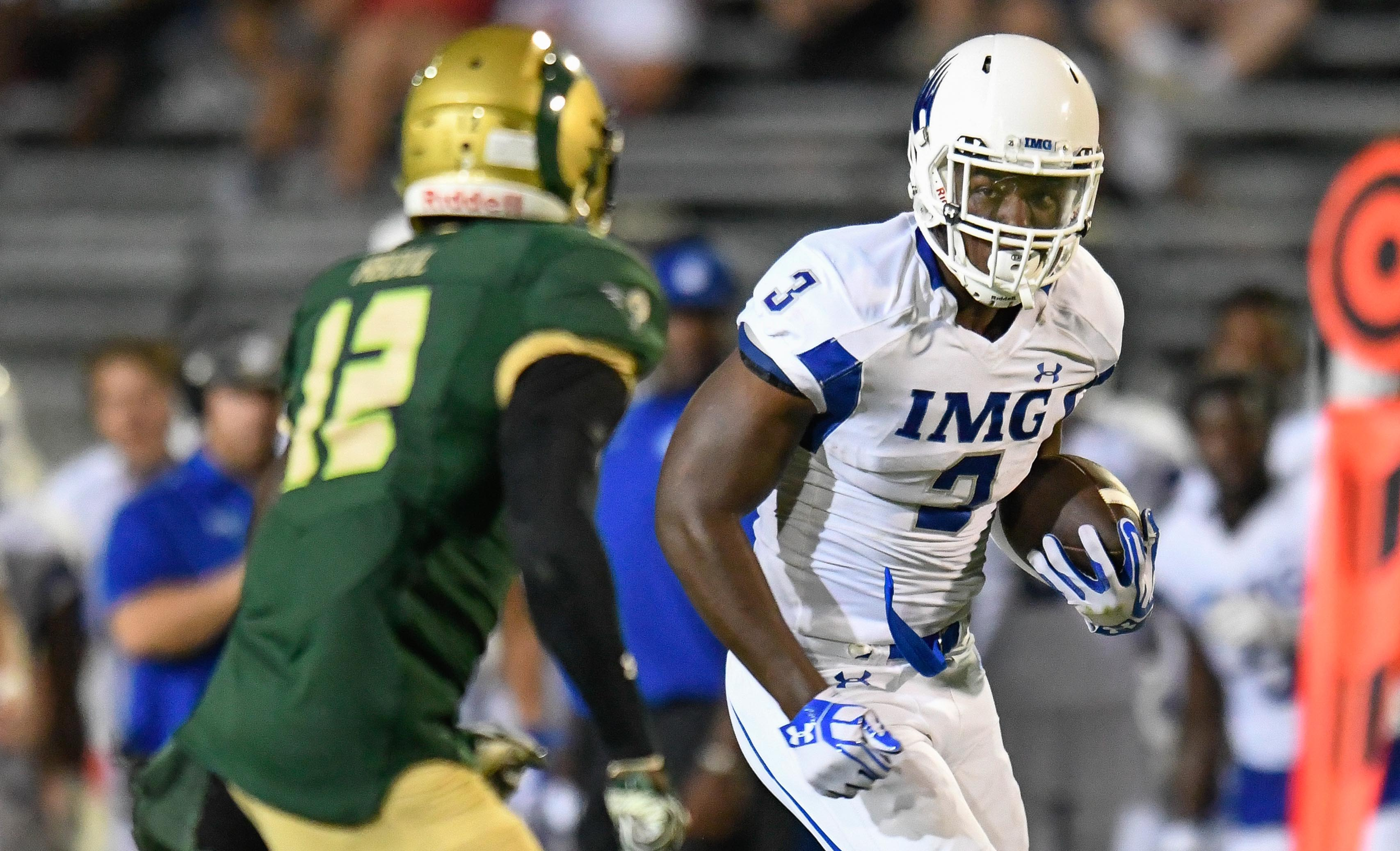 Aug 27, 2016; Loganville, GA, USA; IMG Academy receiver Tre Mckitty (3) runs after a catch against Grayson Rams Josh Stinson (12) during the second half in a high school football duel of top ranked teams at Grayson Community Stadium. IMG Academy defeated the Grayson Rams 26-7. Mandatory Credit: Dale Zanine-USA TODAY Sports ORIG FILE ID: 20160827_sal_sz2_197.JPG