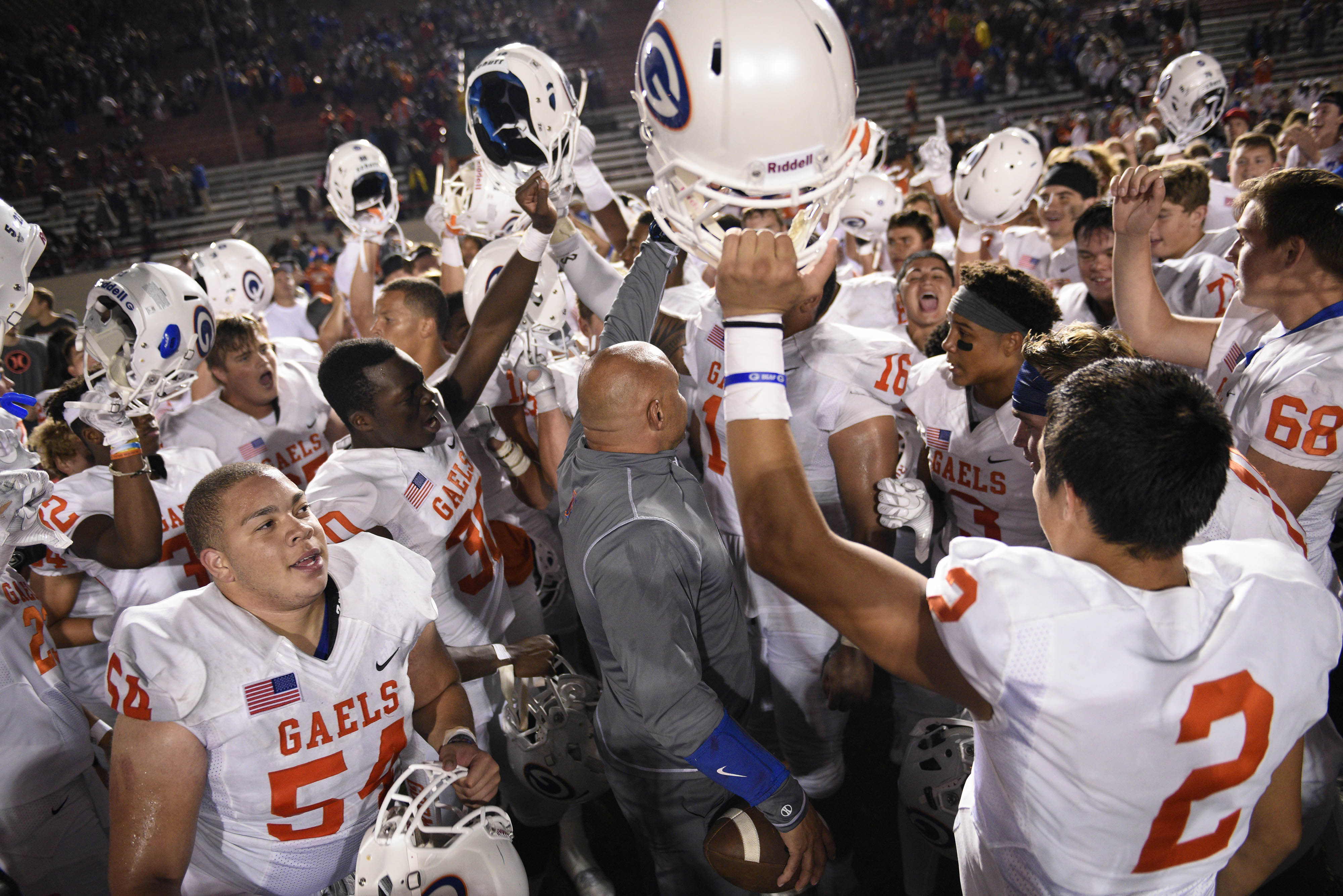 Sep 9, 2016; Long Beach, CA, USA; The Bishop Gorman Gaels celebrate with head coach Kenny Sanchez after the game against the St. John Bosco Braves at Veterans Stadium. The Bishop Gorman Gaels won 35-20. Mandatory Credit: Kelvin Kuo-USA TODAY Sports ORG XMIT: USATSI-326218 ORIG FILE ID: 20160909_kek_ak6_011.JPG
