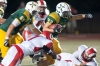 Manual defensive back Bryce Cosby tries to stop the run of St. Xavier running back Samuel Taylor.  07 October 2016