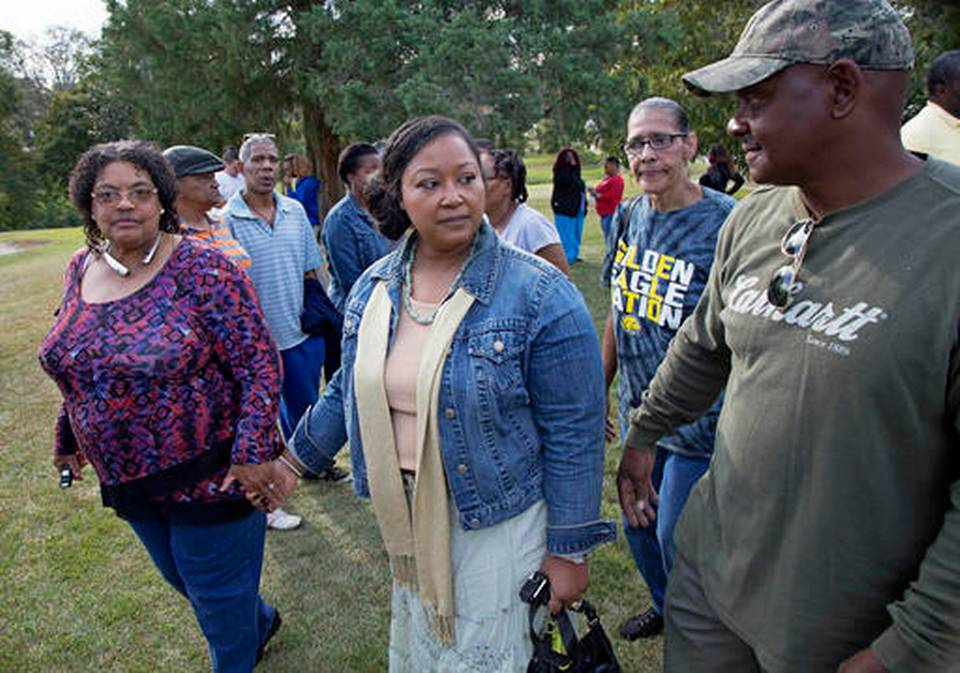 Stacey Payton, center, and Hollis Payton, right, the parents of a high school student, walk with supporters, in front of the Stone County Courthouse in Wiggins, Miss., Monday, Oct. 24, 2016. Johnson is demanding a federal investigation after the parents said four white students put a noose around their son's neck at school. Max Becherer AP Photo Read more here: http://www.charlotteobserver.com/news/nation-world/national/article110290197.html#storylink=cpy