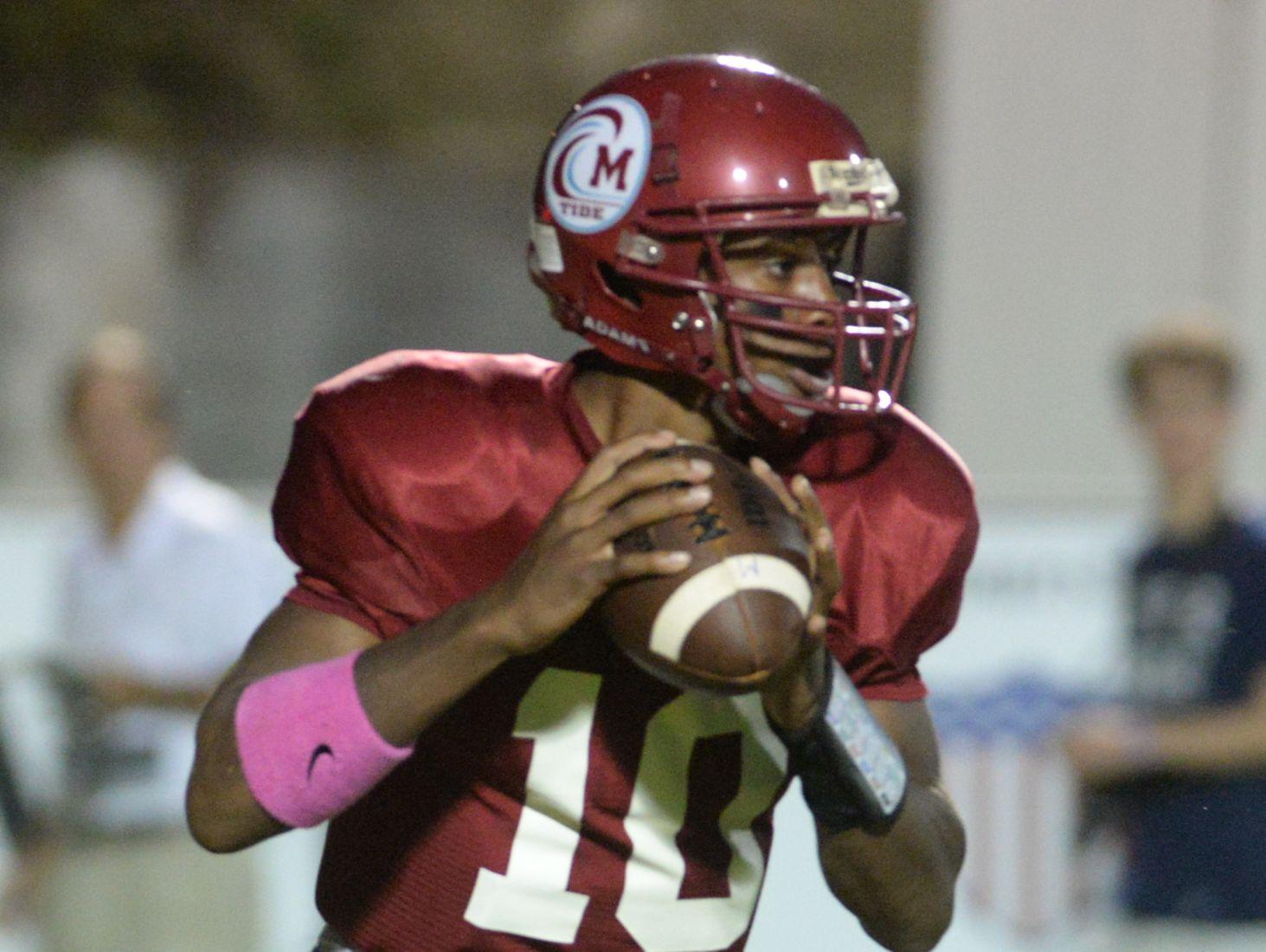 Minden quarterback Antonio Rivette drops back for a pass against Loyola October 10, 2014.