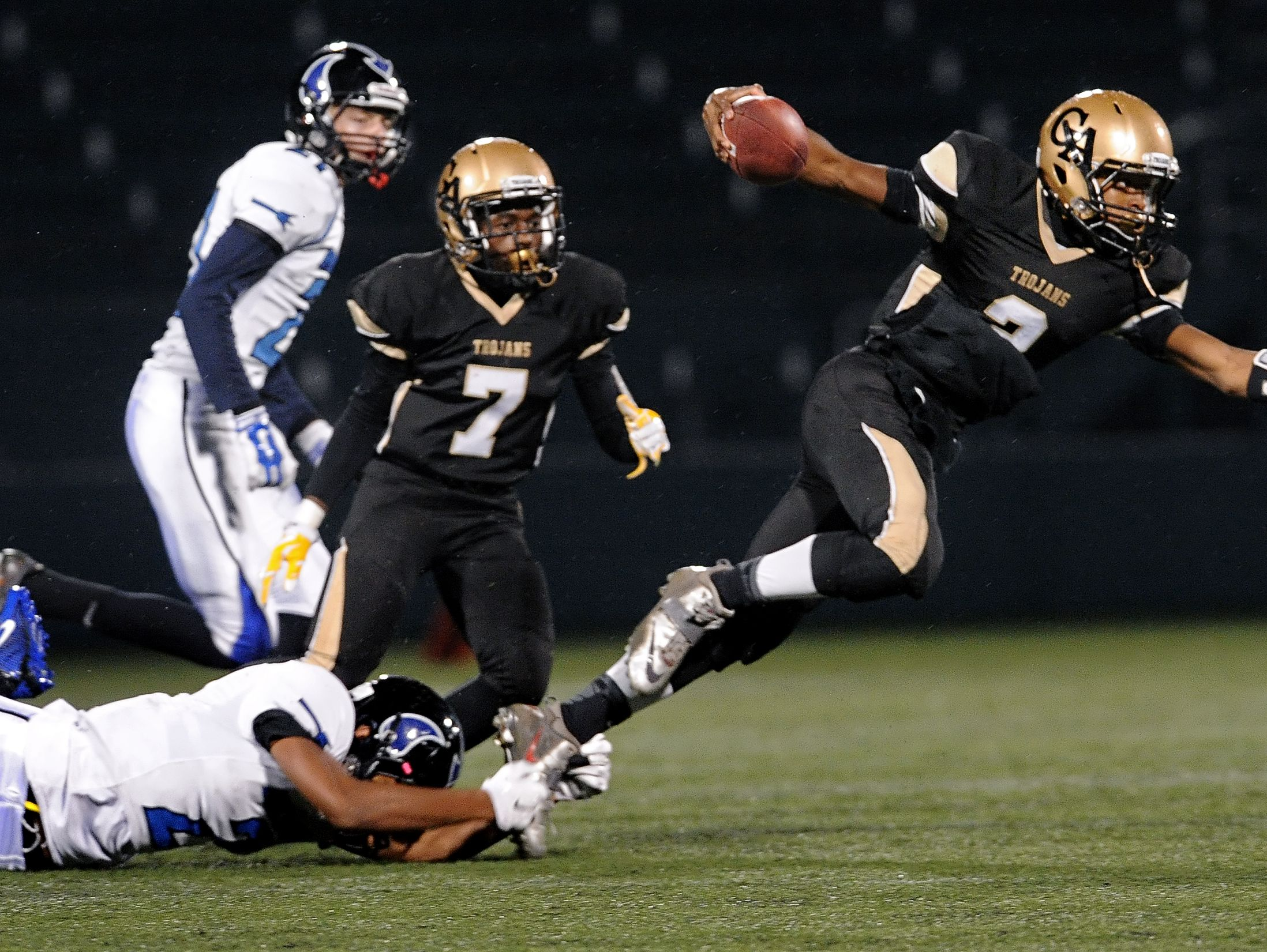Greece Athena's Tavon Granison, right, is tripped up by Brockport's Rapeal Odey.