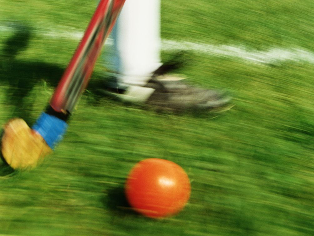 Girl playing field hockey (blurred motion)