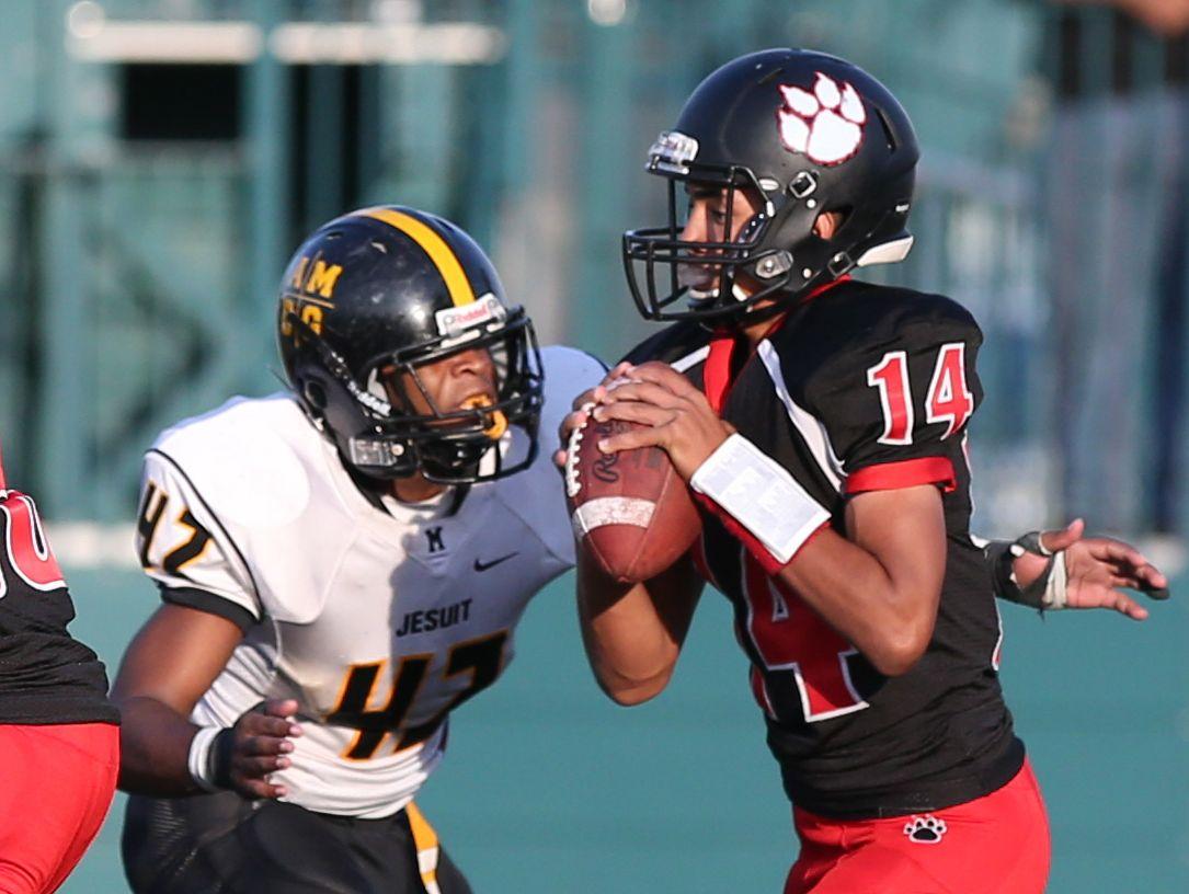 McQuaid's Rickey King, ready to sack Wilson quarterback James Cotton during a 2015 regular season game, led a solid effort against Rush-Henrietta last Saturday.