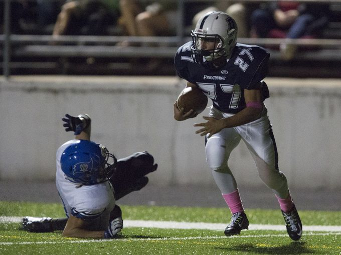 Providence's Kaden Williams runs back a kick in last year's meeting with Charlestown.