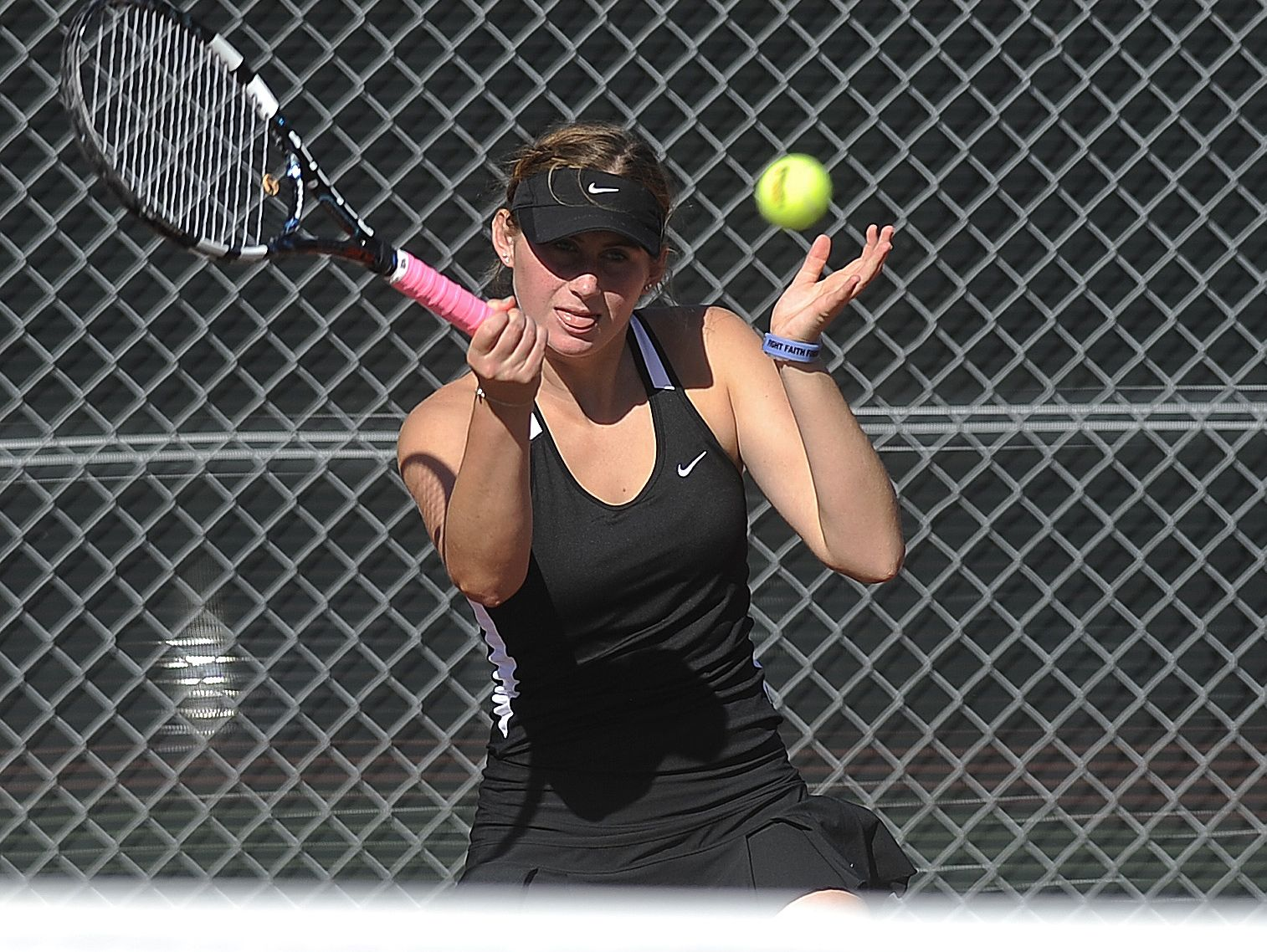 St. Thomas More's Grace Goble returns the ball to O'Gorman's Danielle Sabata and Samantha Czarnecki during the doubles championship finals of the SD high school girls state tennis tournament at McKennan Park in Sioux Falls, SD; Saturday, Oct. 10, 2015.