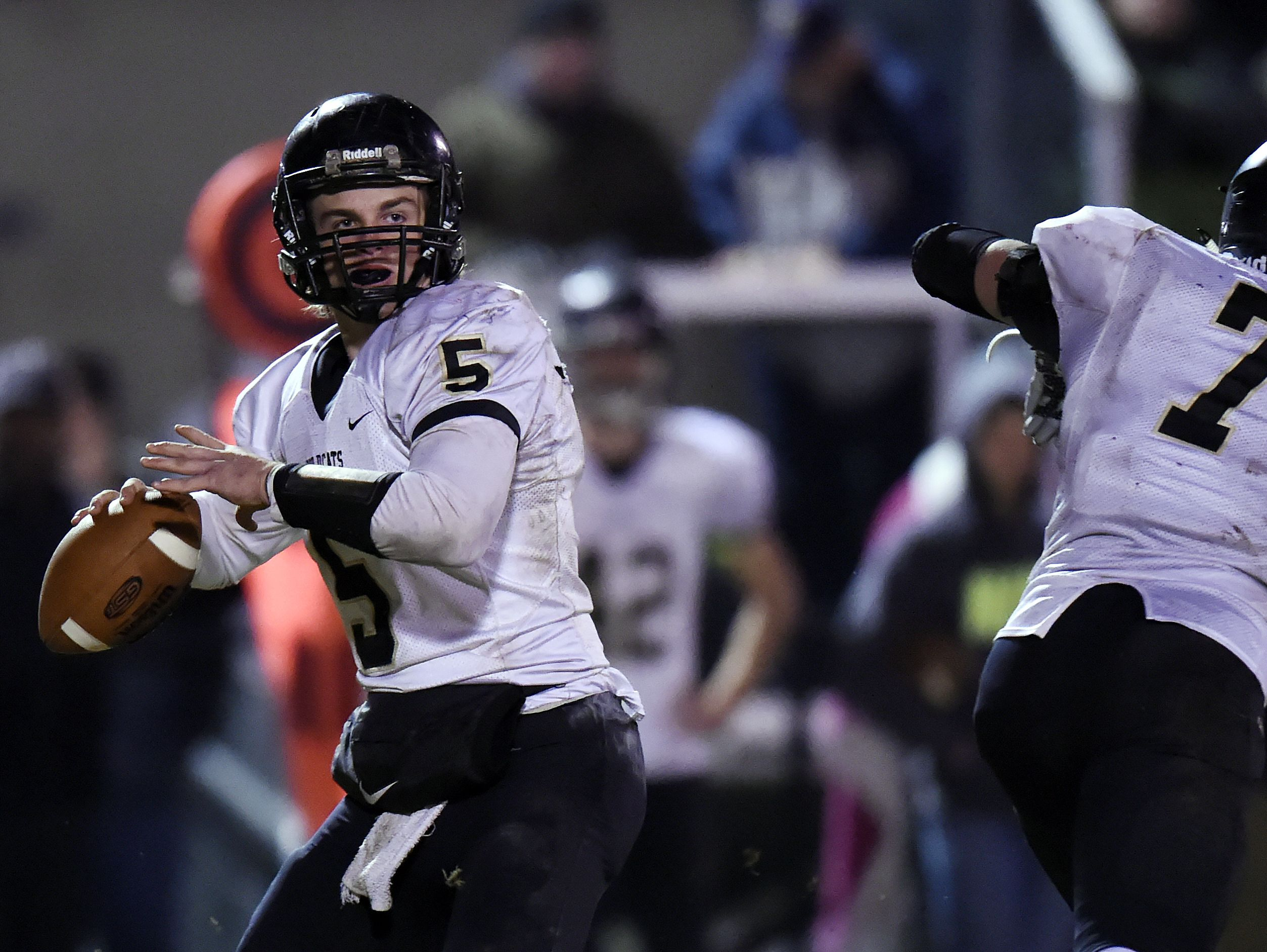 Wayne County quarterback Preston Rice (5) passes against Nashville Christian in the second half of an 1A quarterfinal playoff football game at Nashville Christian High School on Friday, Nov. 20, 2015 in Nashville, Tenn. Nashville Christian won 34-21.