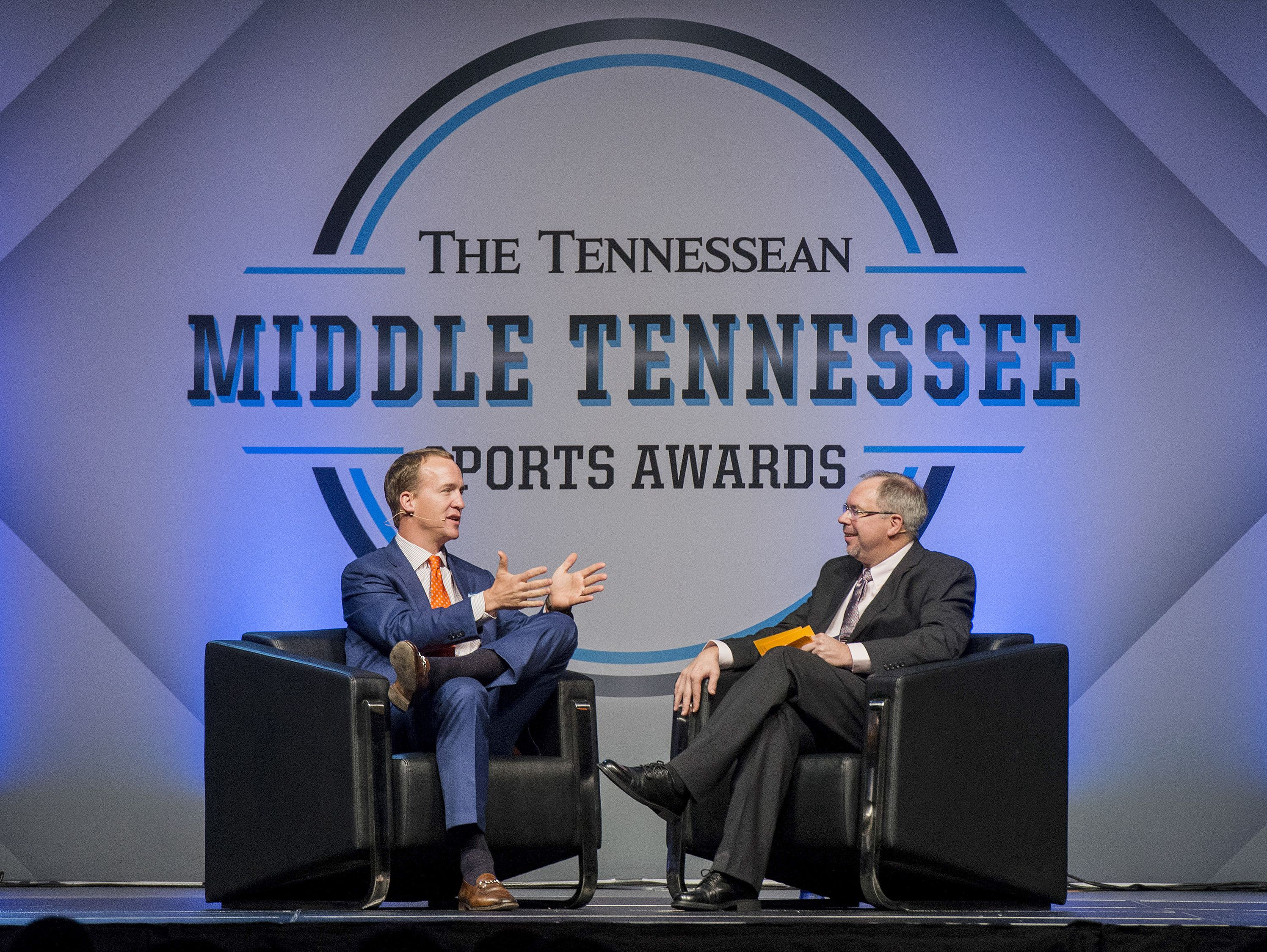 Peyton Manning, left, and The Tennessean's Dave Ammenheuser, right, speak during a Q and A at the Middle Tennessee Sports Awards at Music City Center, Thursday, May 26, 2016, in Nashville, Tenn.