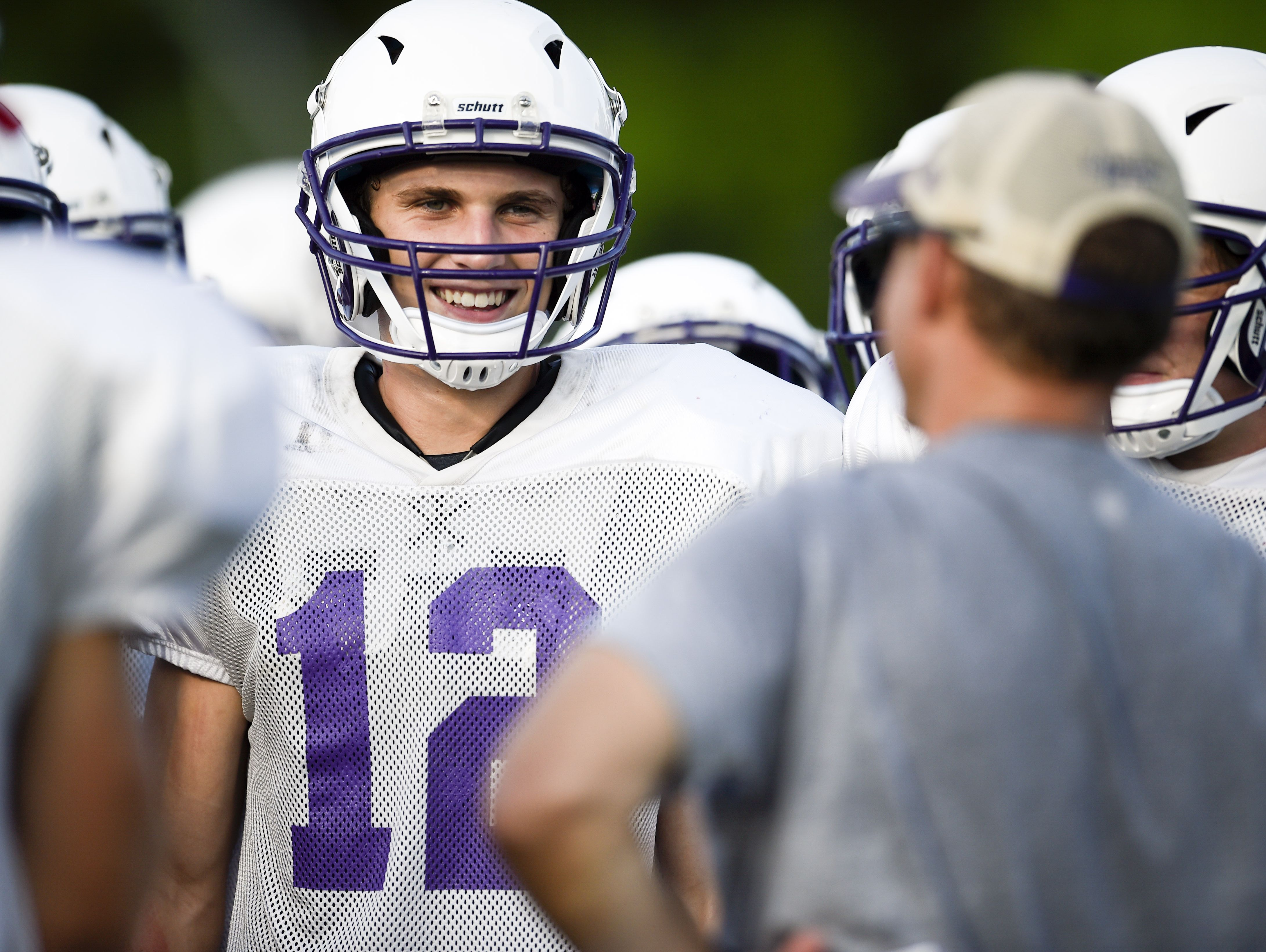 Father Ryan's Ryan Shoop (12) listens to instructions from Brian Rector during a practice at Father Ryan High School.