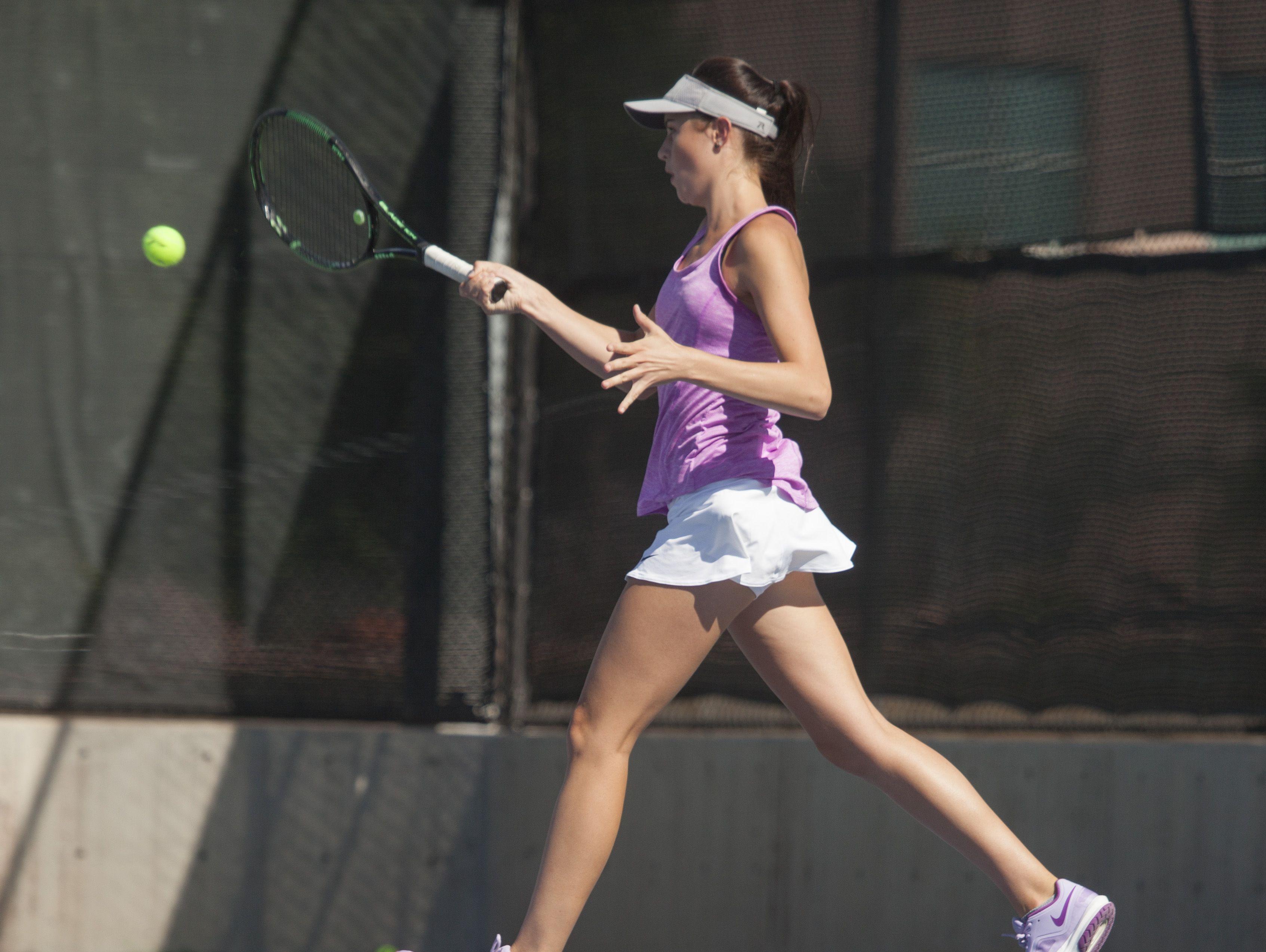 Desert Hills and Dixie girls tennis face off at the start of their season at Desert Hills High School Tuesday, August 16, 2016.
