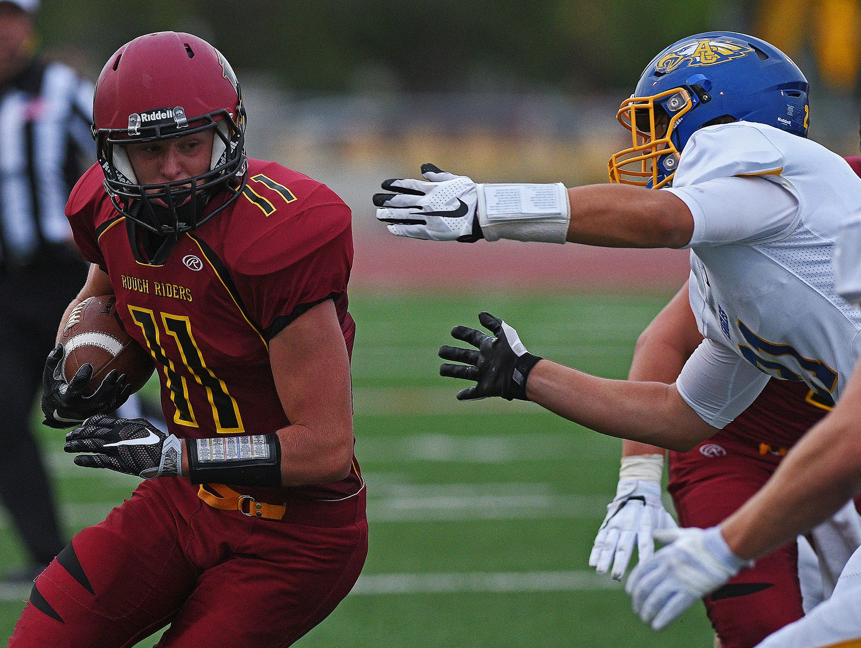 Roosevelt's Nathan Varns (11) rushes with the ball during a game against Aberdeen Central Friday, Aug. 26, 2016, at Howard Wood Field in Sioux Falls.