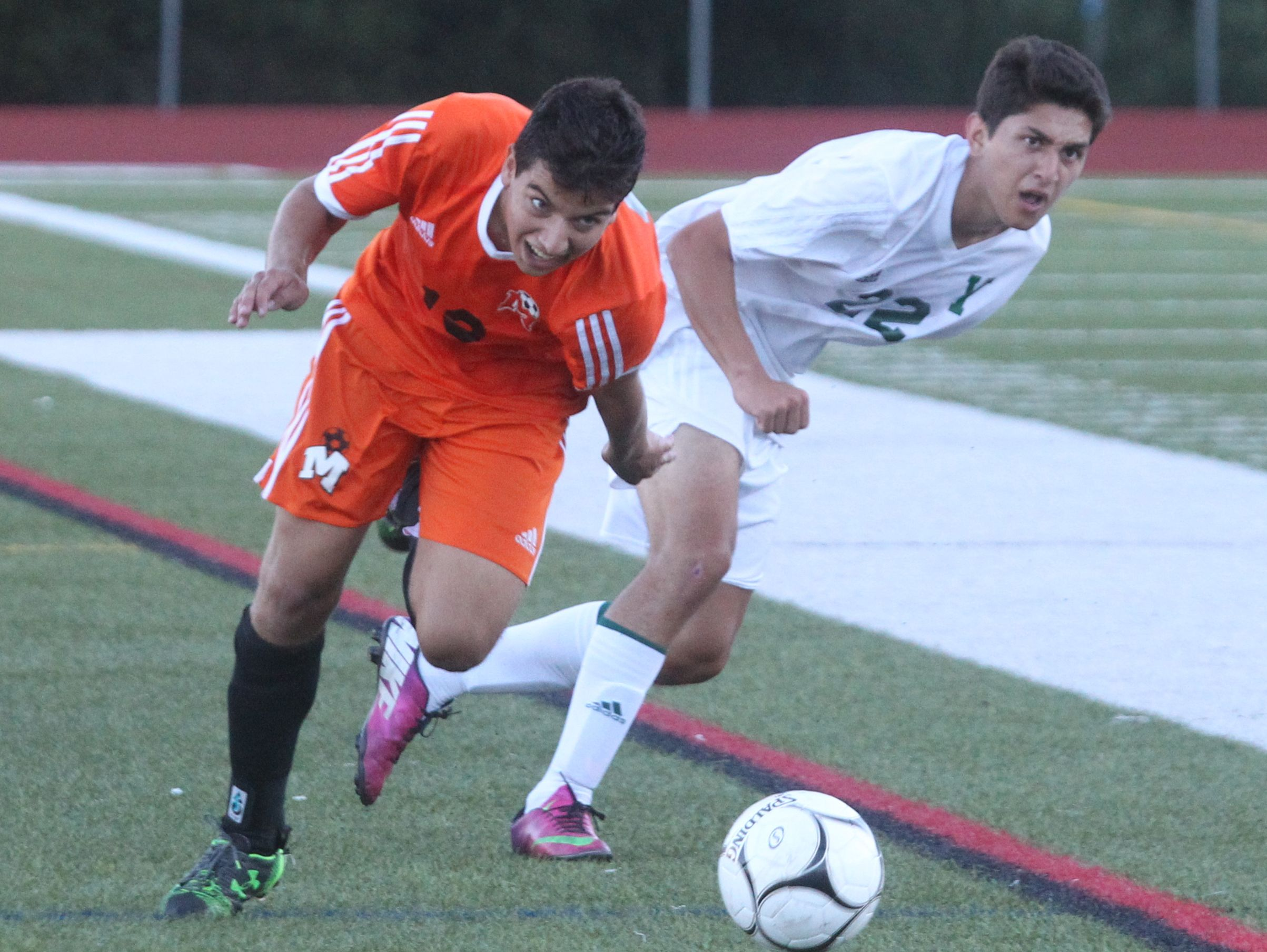 Mamaroneck and Yorktown are shown doing battle on Sept. 12. Vin Mercogliano has the Tigers capturing the Section 1 Class AA title.