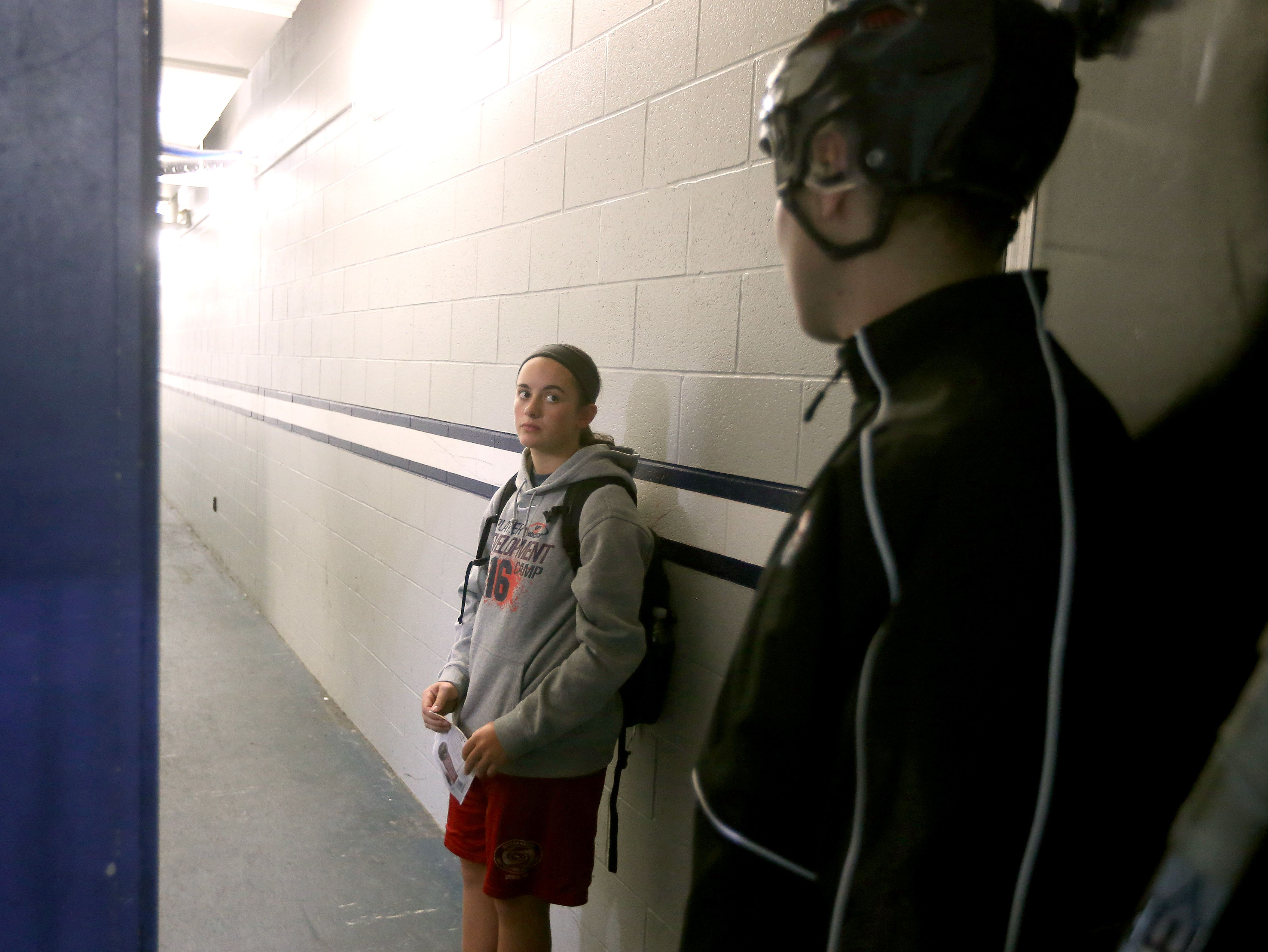 Bishop Kearney hockey player Mackenzie Emery talking with head coach Chris Baudo before practice. Emery was recovering from a concussion. Kearney is in its first year of an elite girls hockey program at the private school in Irondequoit.