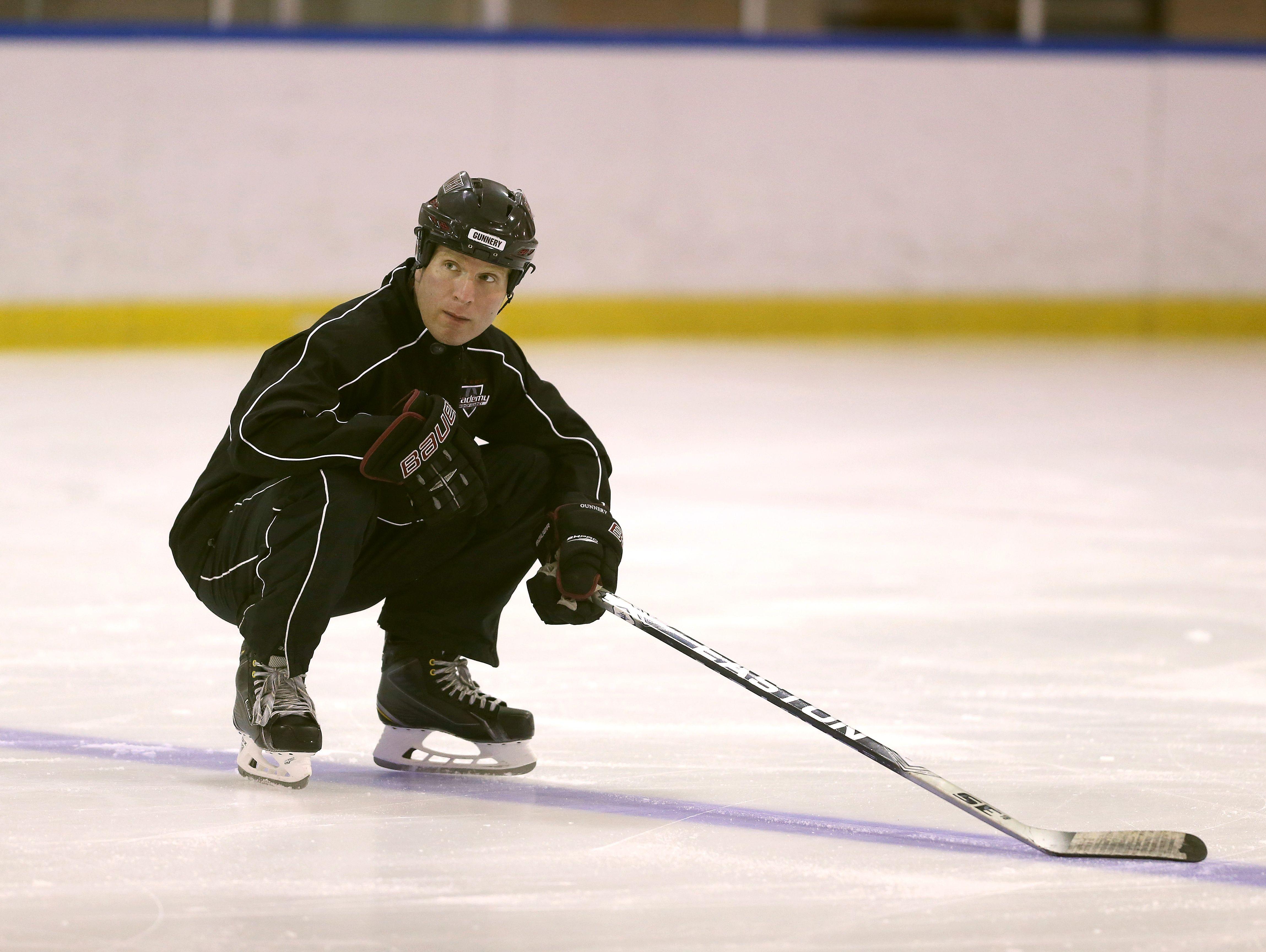 Bishop Kearney girl's hockey coach Chris Baudo runs a drill at practice.