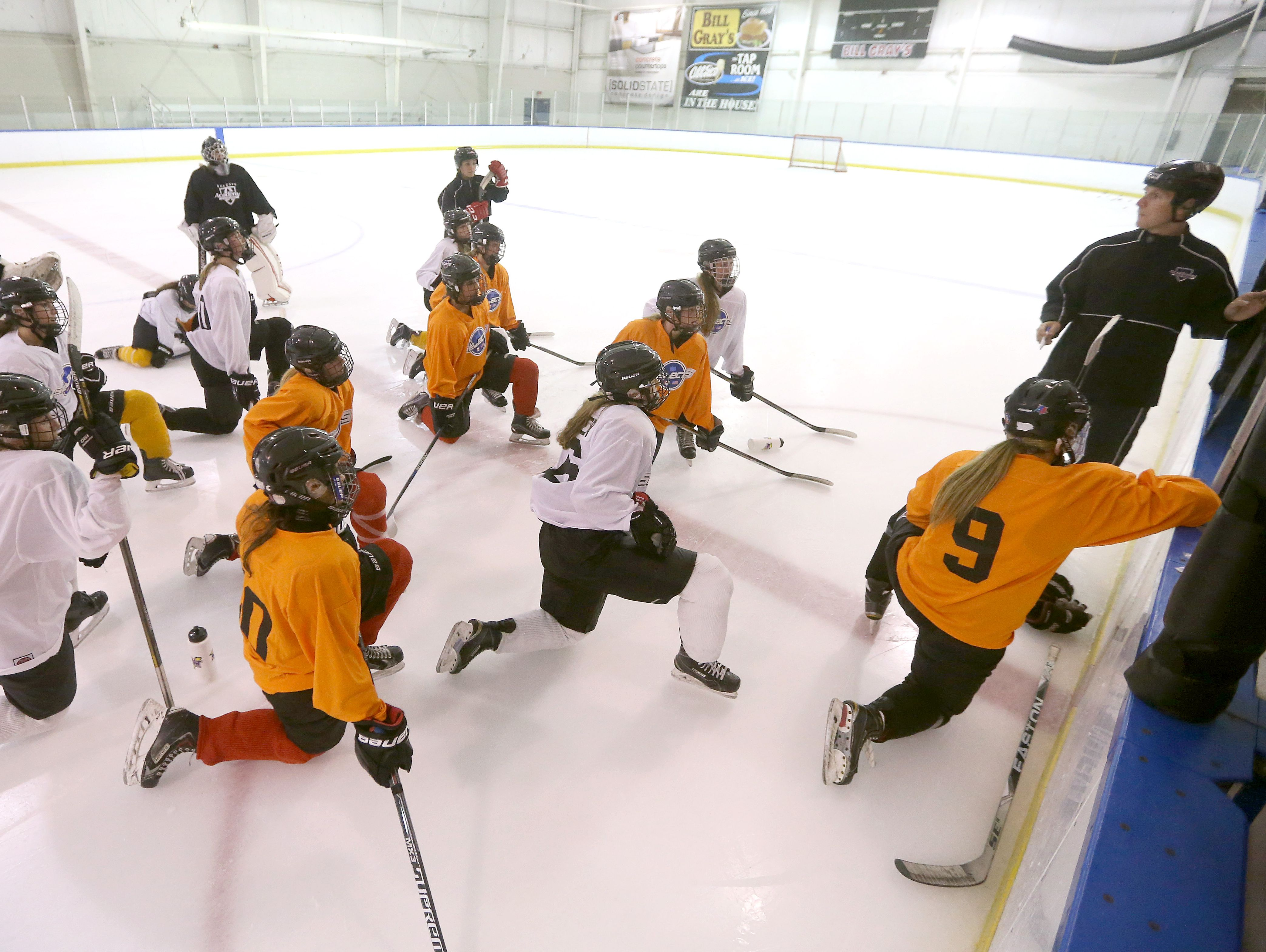 Bishop Kearney head coach Chris Baudo explains a drill to his girls hockey team during a recent practice at the Bill Gray's Regional Iceplex. The first-year program is off to a fast start.