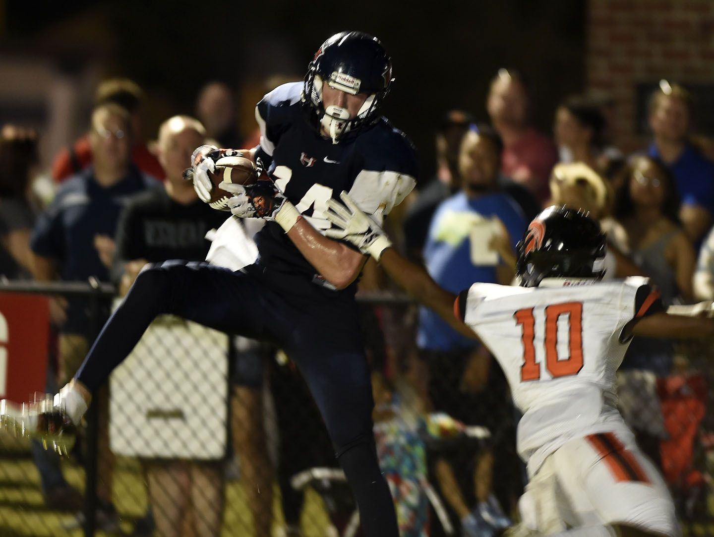 WH Heritage's Nick Desmarais (14) pulled down six catches for 231 yards and three touchdowns on Friday.
