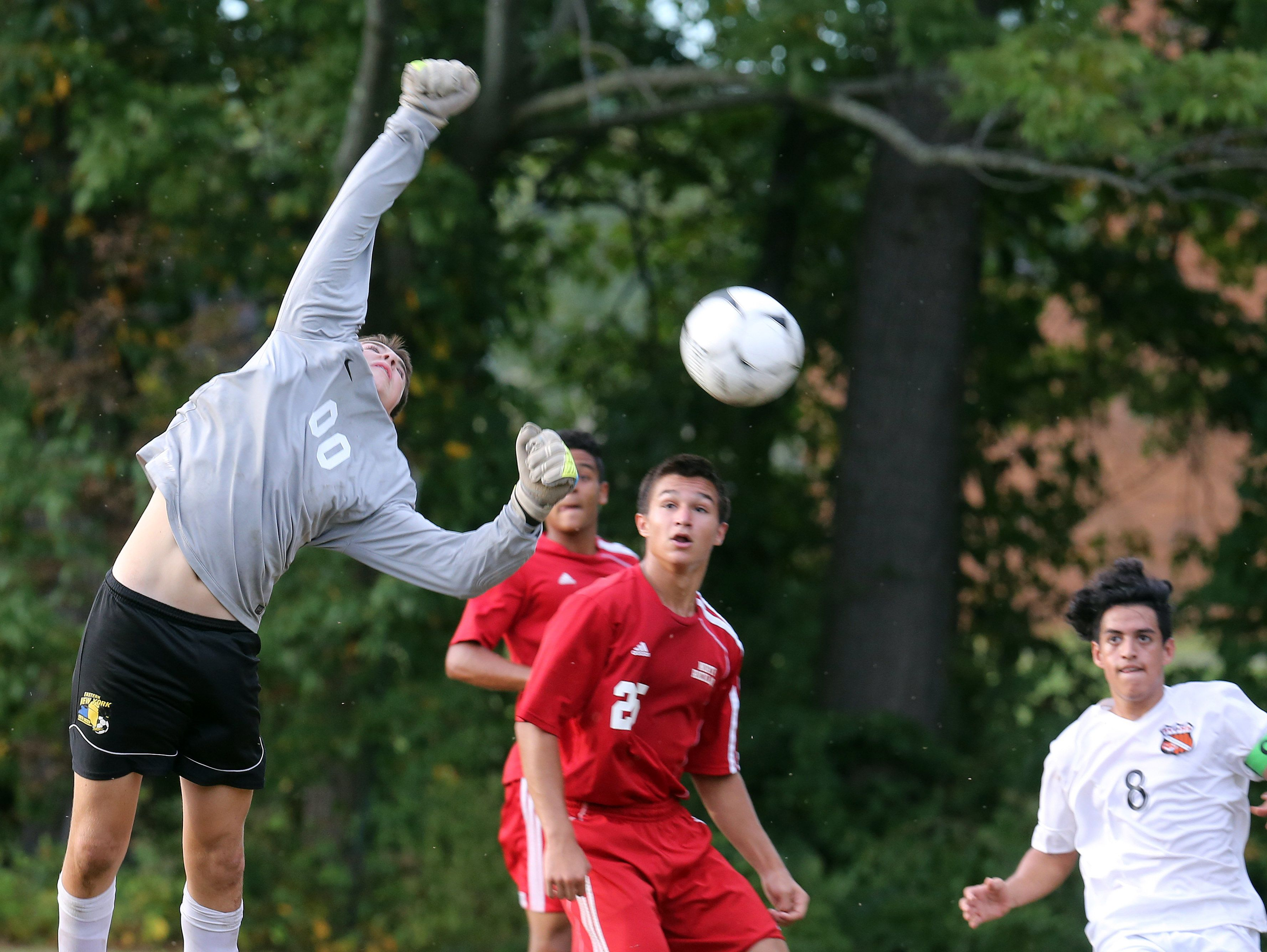 North Rockland's goalie Josh Heber (00) tries to block the shot during boys soccer game at Spring Valley High School on Sept. 20, 2016.