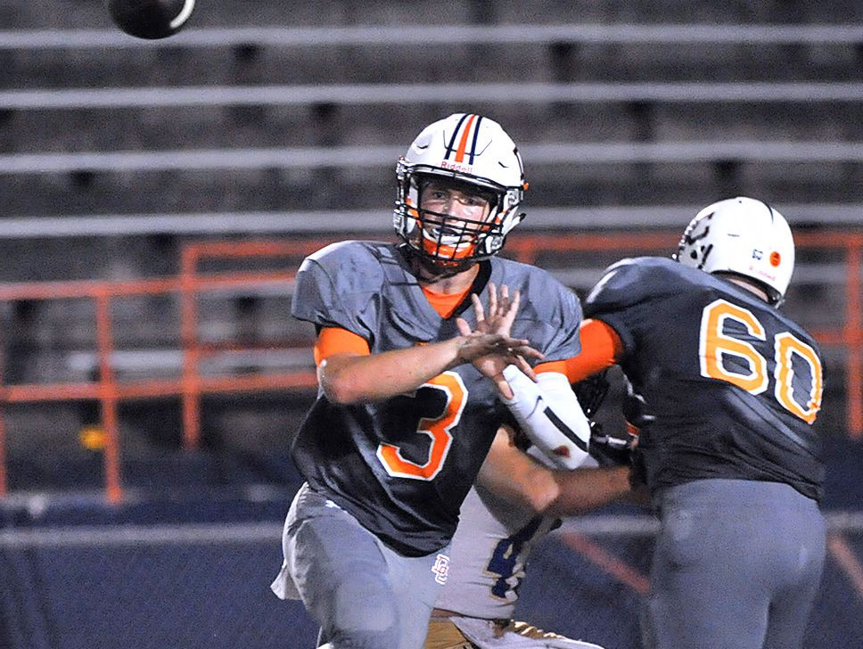 Dickson County quarterback Jacob Murphree fires a completion against Brentwood.