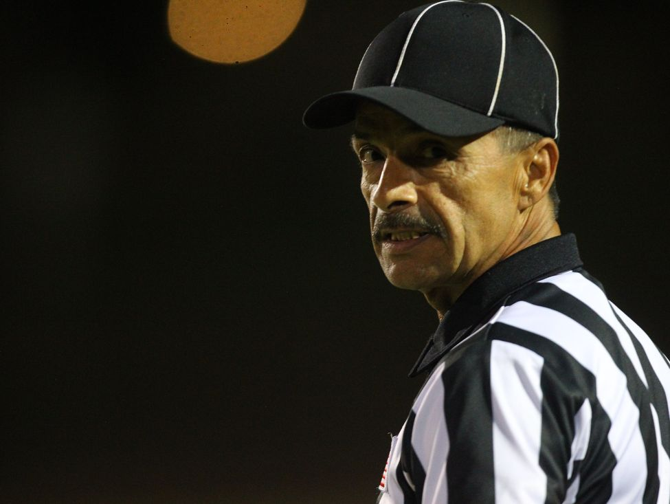 A referee looks on early in the 2016 season.