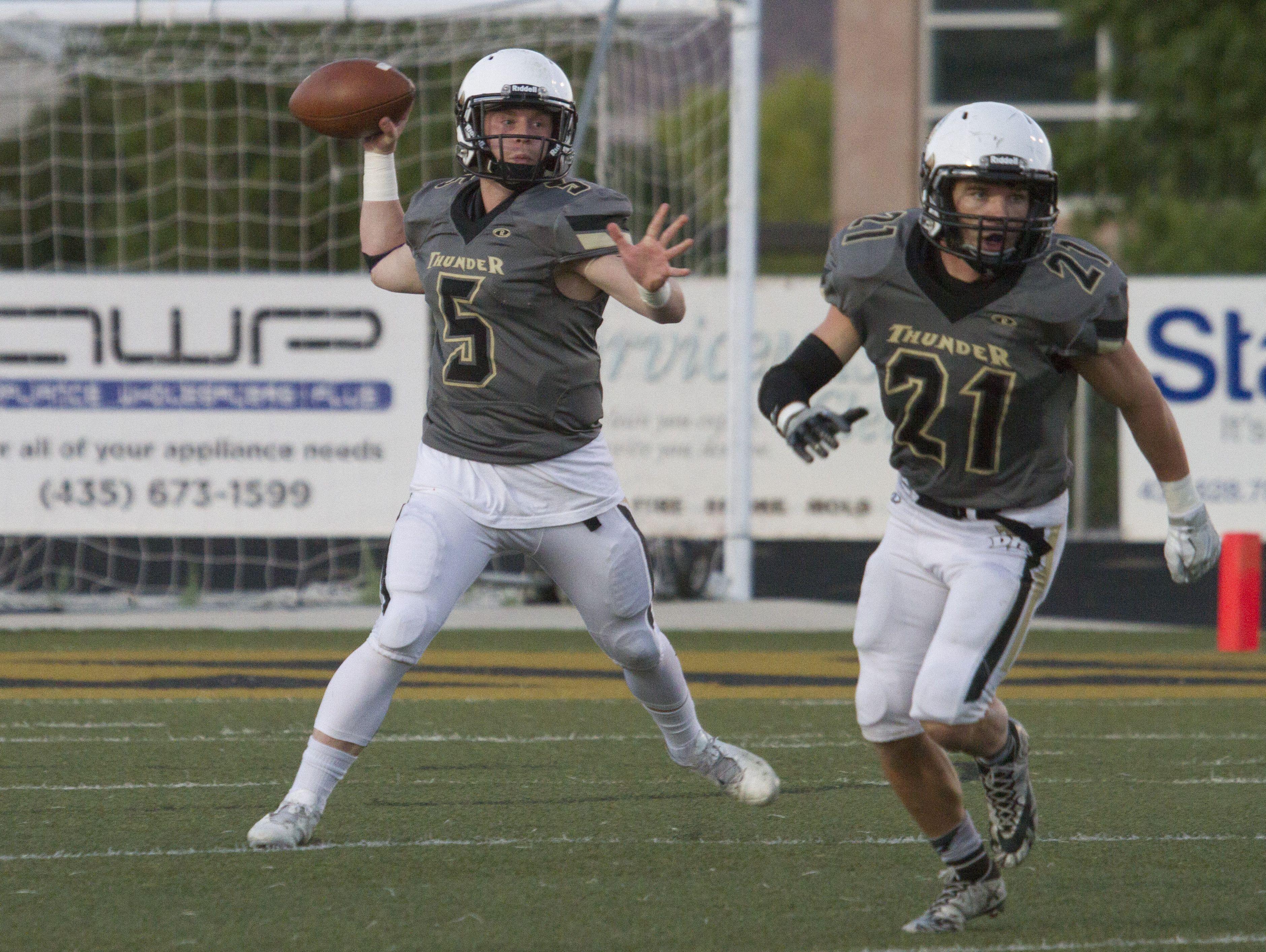 Desert Hill quarterback Quinn Kiser throws a pass during their game against Hurricane High School Friday, Sept. 23, 2016.
