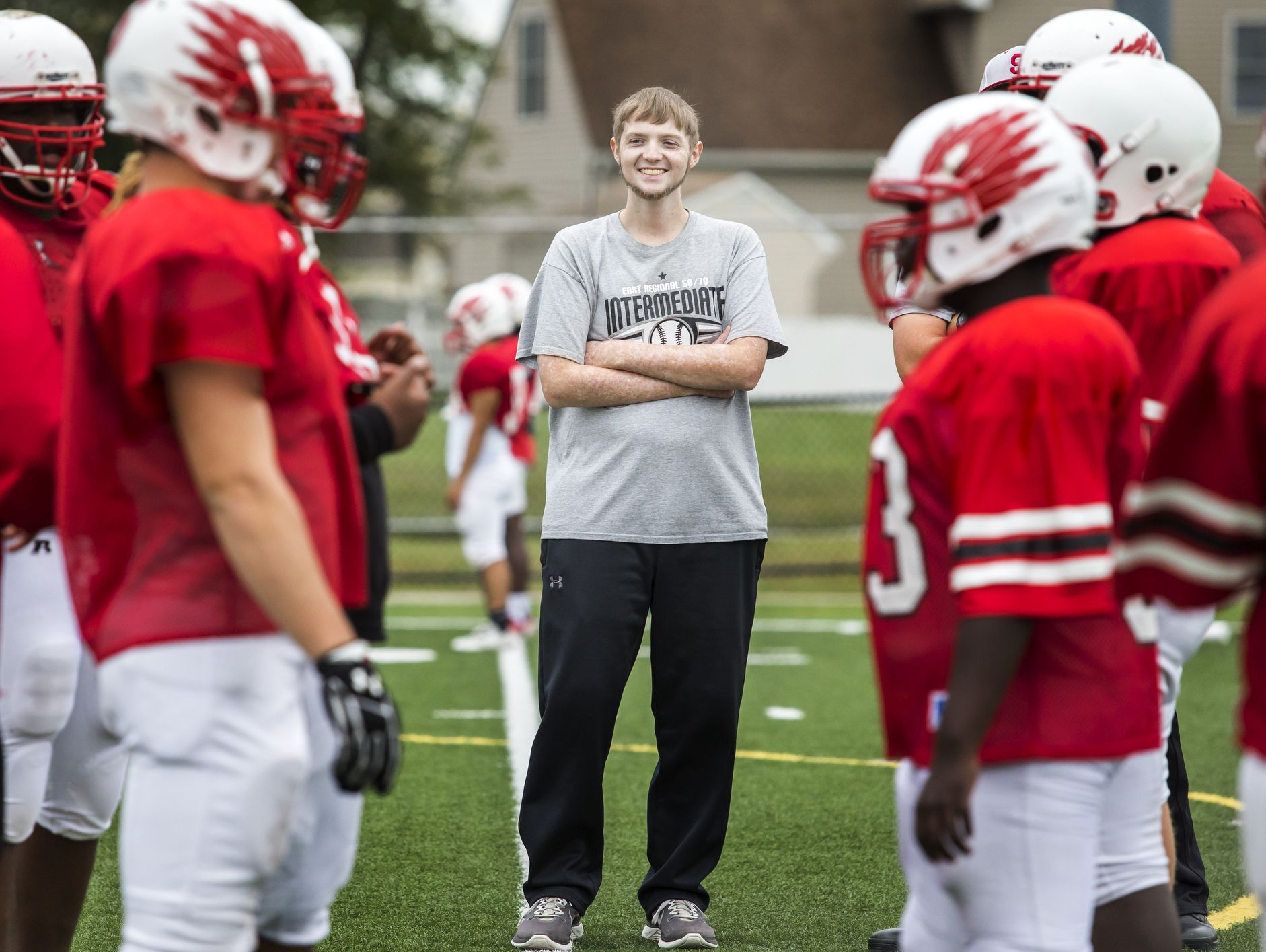 Colby Atkinson watches as lineman on the Smyrna High School football team line up for drills at practice on Wednesday afternoon.