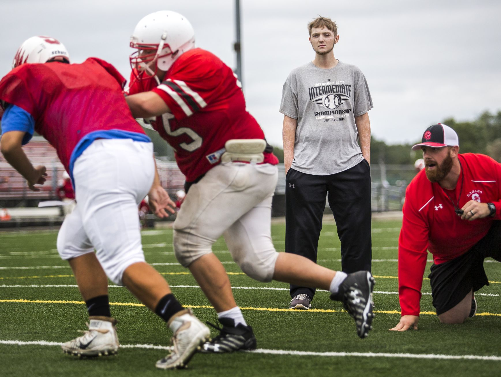 Colby Atkinson watches as Smyrna High linemen run through drills during practice last week.