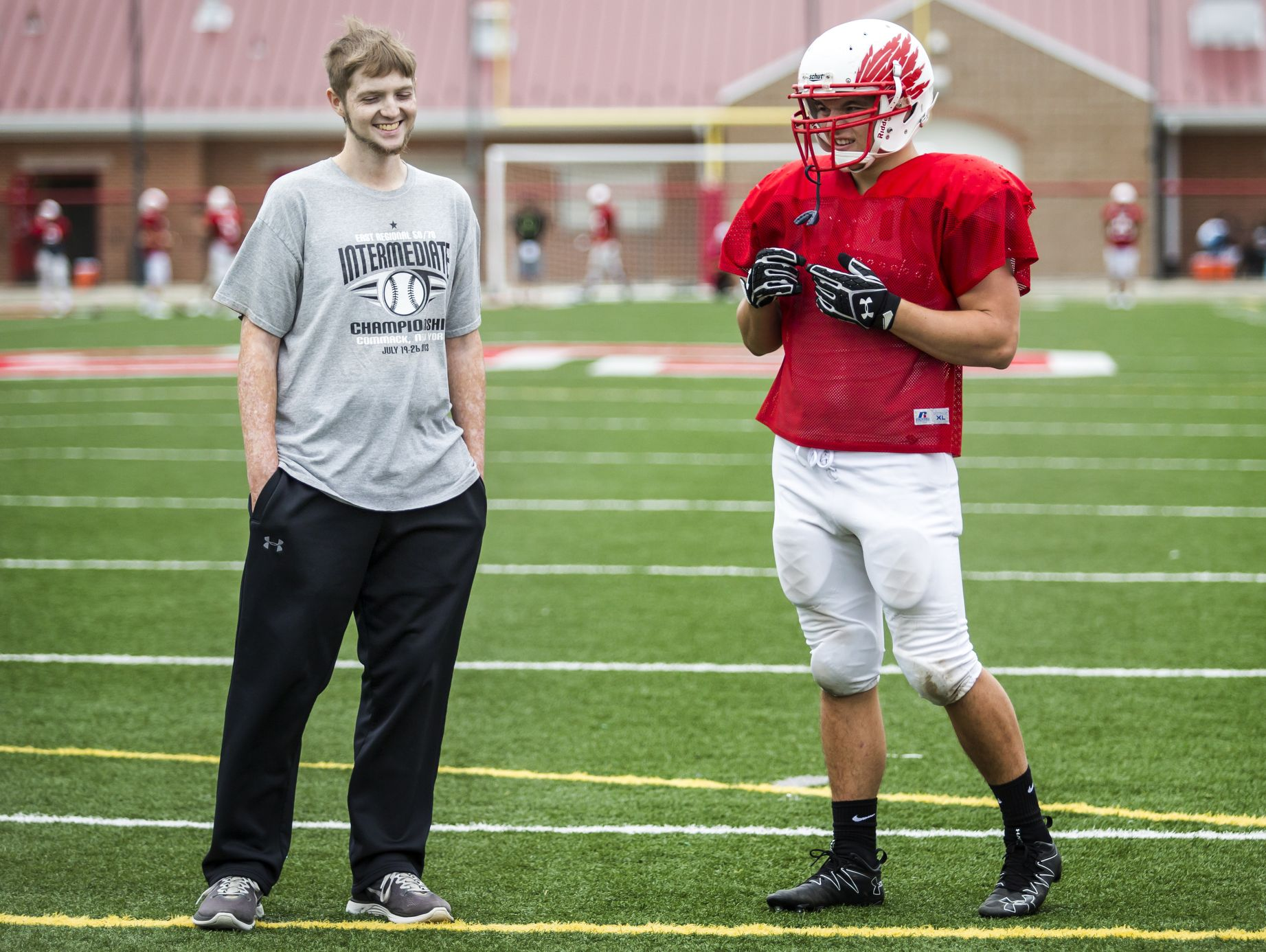 Colby Atkinson talks with a teammate at Smyrna High football practice last week.