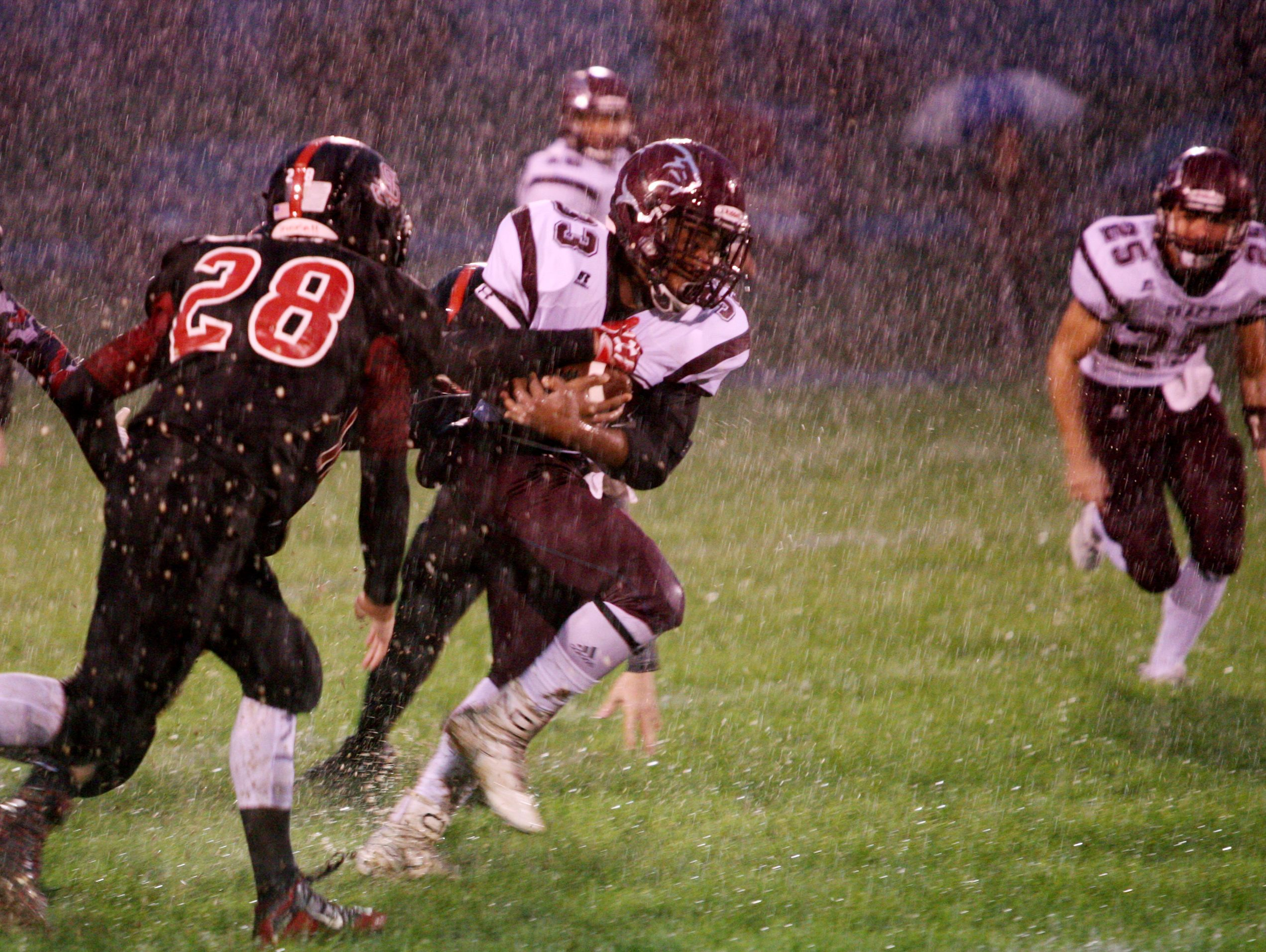 Stuarts Draft's Izzy Johnson runs for one of his two touchdowns during the first half of Friday night's win over Stonewall Jackson.