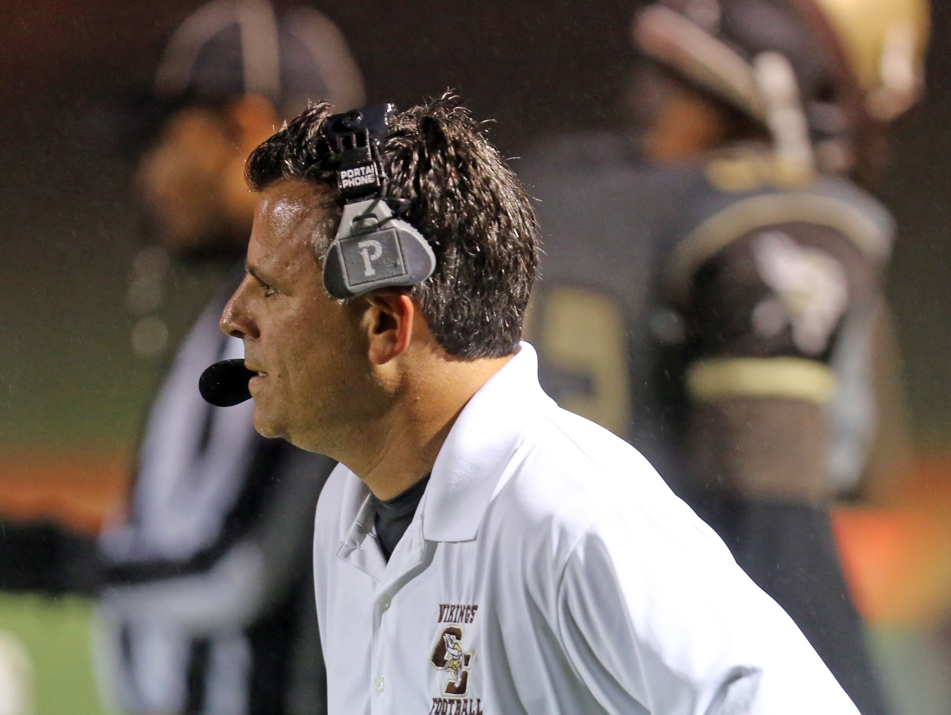 Clarkstown South coach Mike Scarpelli is pictured during his team's 39-18 loss to New Rochelle at Clarkstown South High School in West Nyack on Sept. 30, 2016.