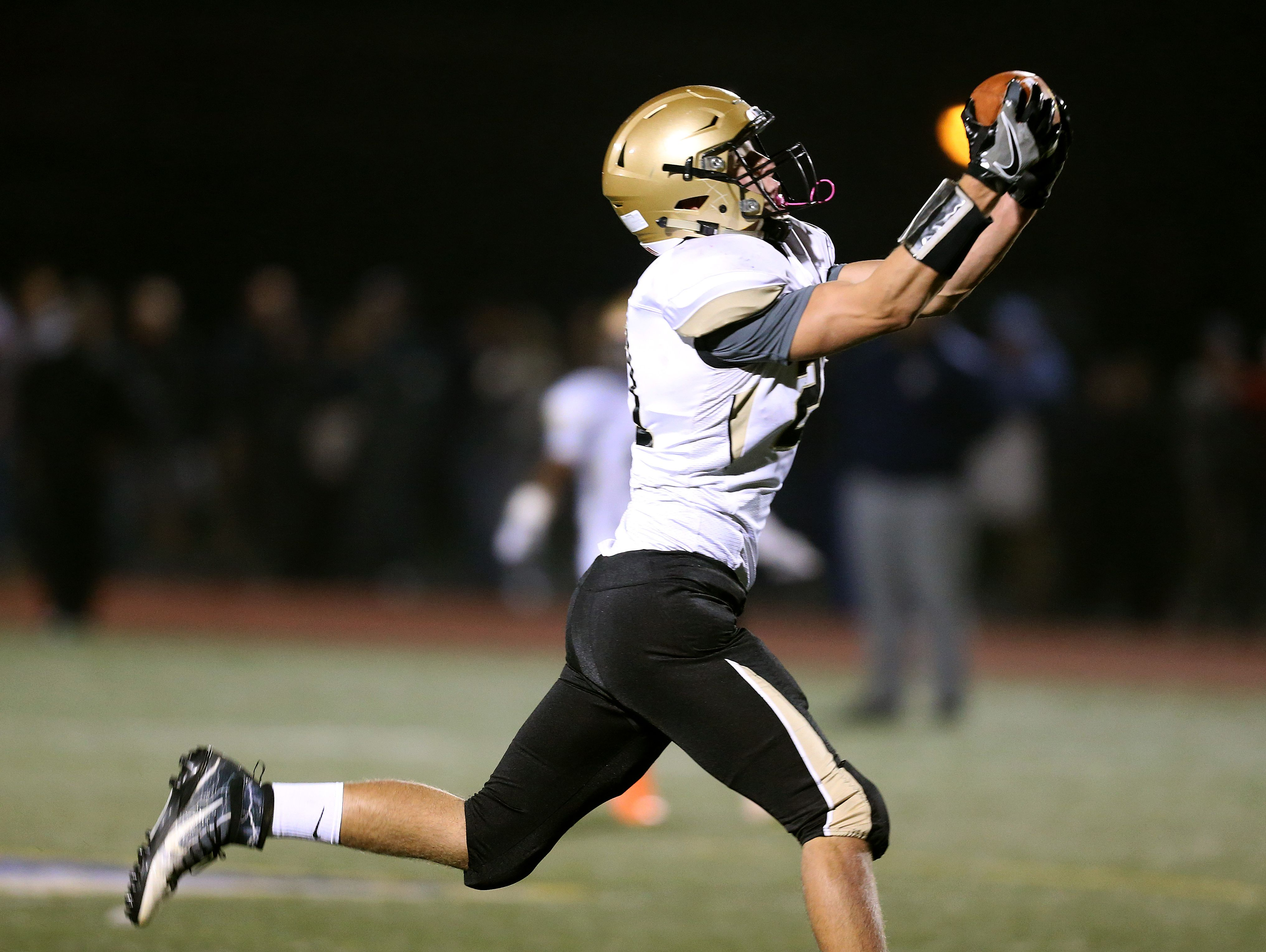 Greece Athena's Kyle Benham catches a deep pass for a touchdown against Brighton.