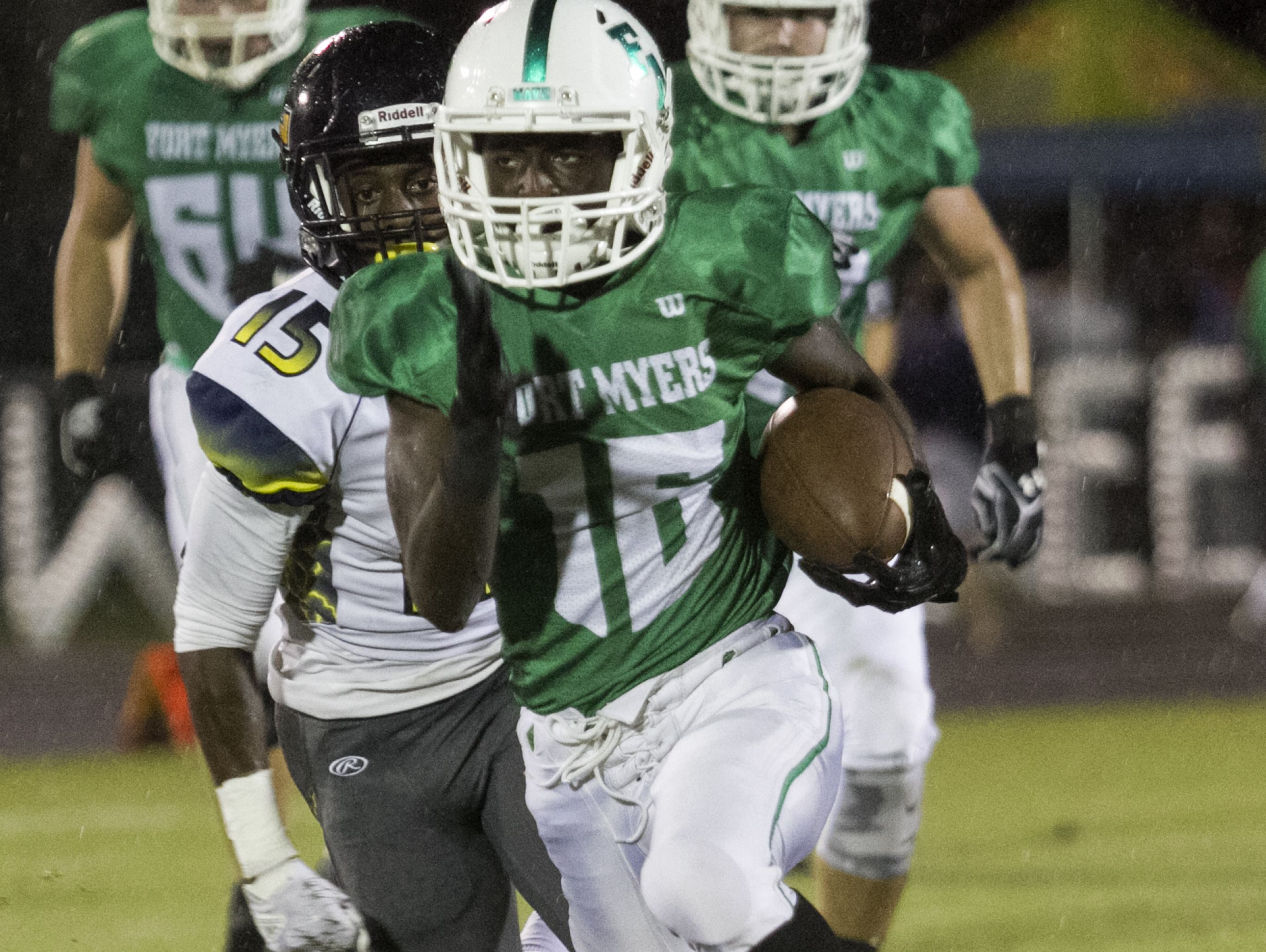 Yasias Young of Fort Myers is chased by Lehigh's Arthur Nance on Friday night at Fort Myers High School.