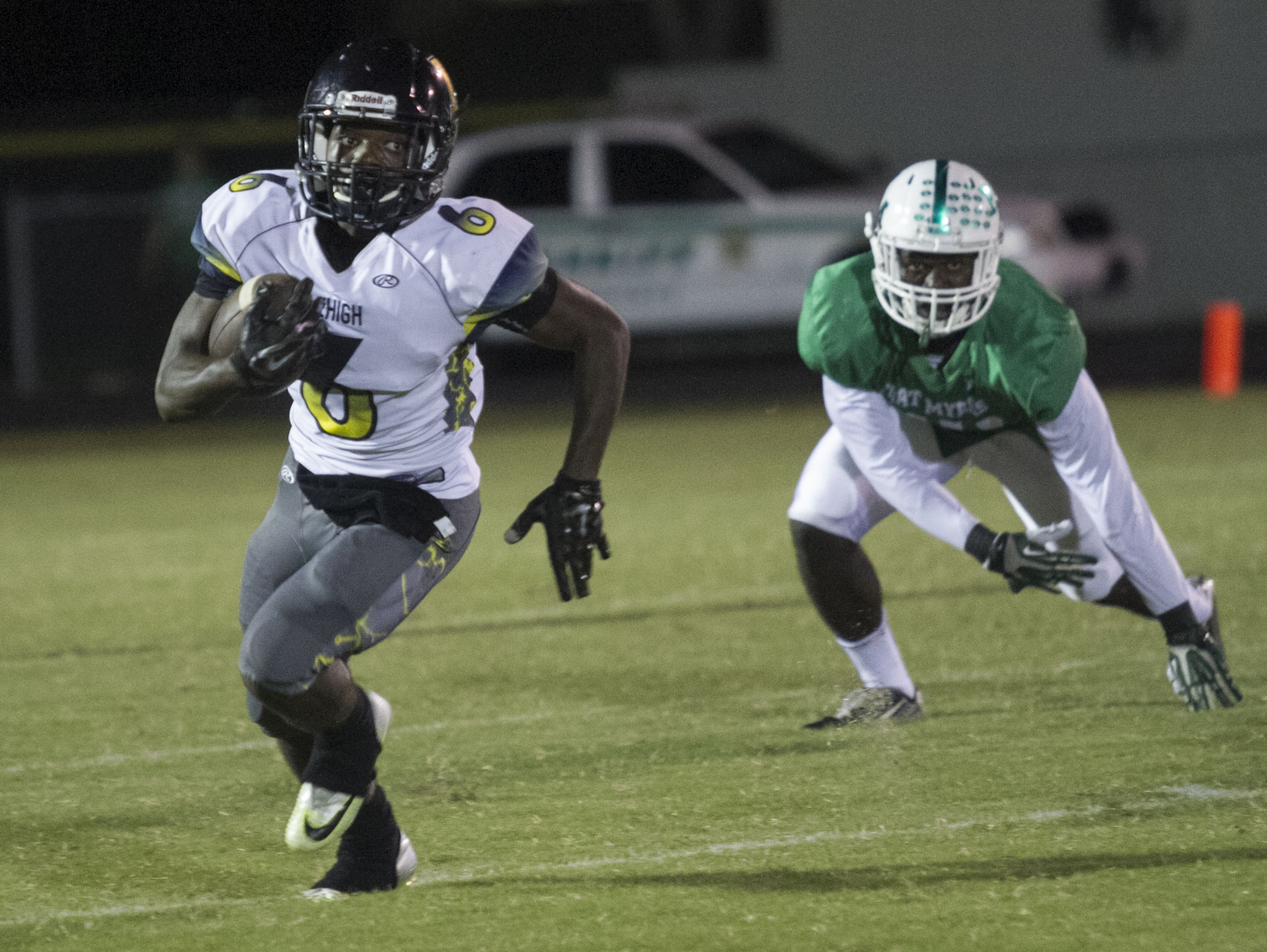 Lehigh's Jalane Nelson runs the ball for the Lightning on Friday night at Fort Myers High School.