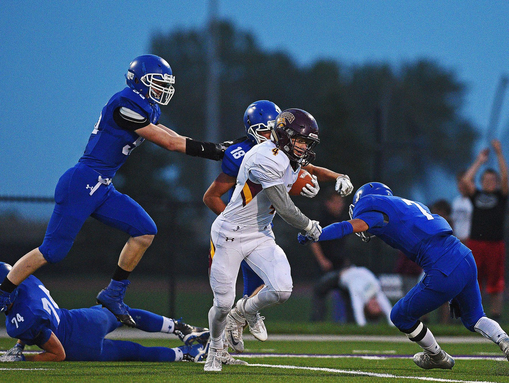 Madison's Mason Leighton (4) rushes with the ball during a game against Sioux Falls Christian Friday, Sept. 30, 2016, at Bob Young Field in Sioux Falls. The game against the Bulldogs was the first time Sioux Falls Christian had faced a Class 11A team during the season.