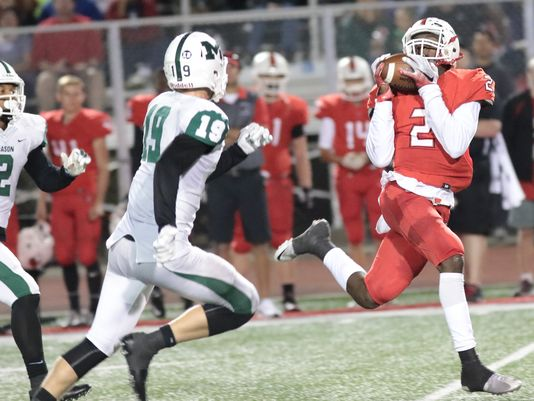 Colerain's Ja'von Hicks catches a touchdown pass at the end of the first half (Photo: Tony Tribble, The Enquirer)