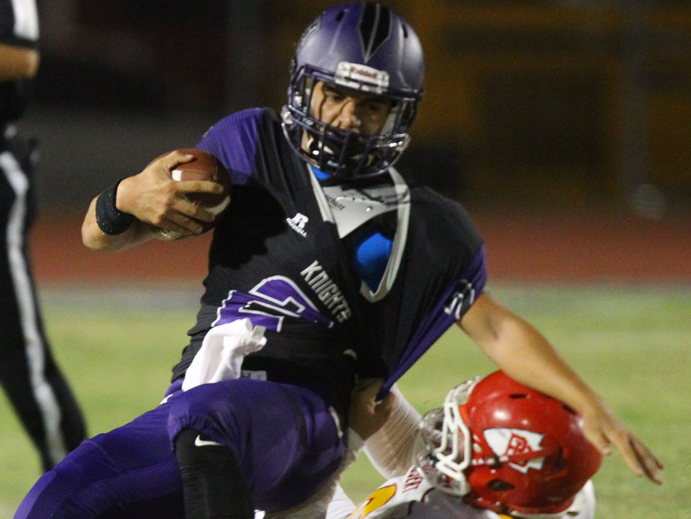 Shadow Hills High School's Seth Morales is sacked by Palm Desert High School's #70 during their game at Indio.