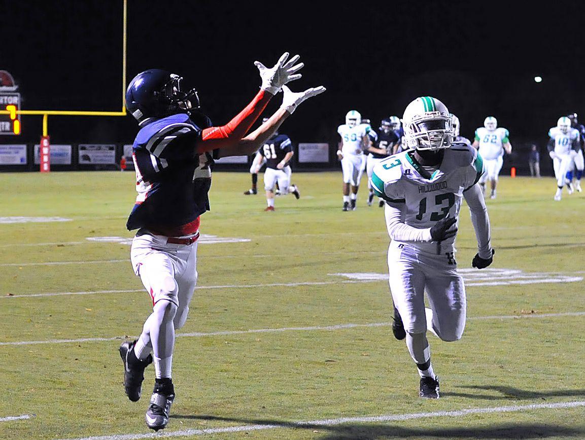 Creek Wood's Braxton Horner gets past Hillwood's Eric Kinnard for a touchdown grab.