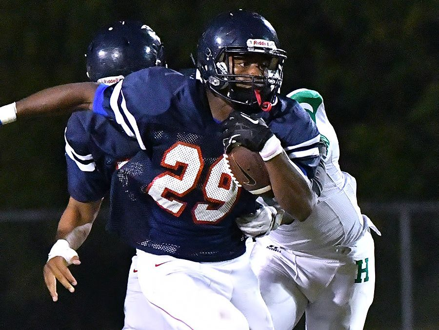Creek Wood running back Quinton Poole looks for running room against Hillwood.