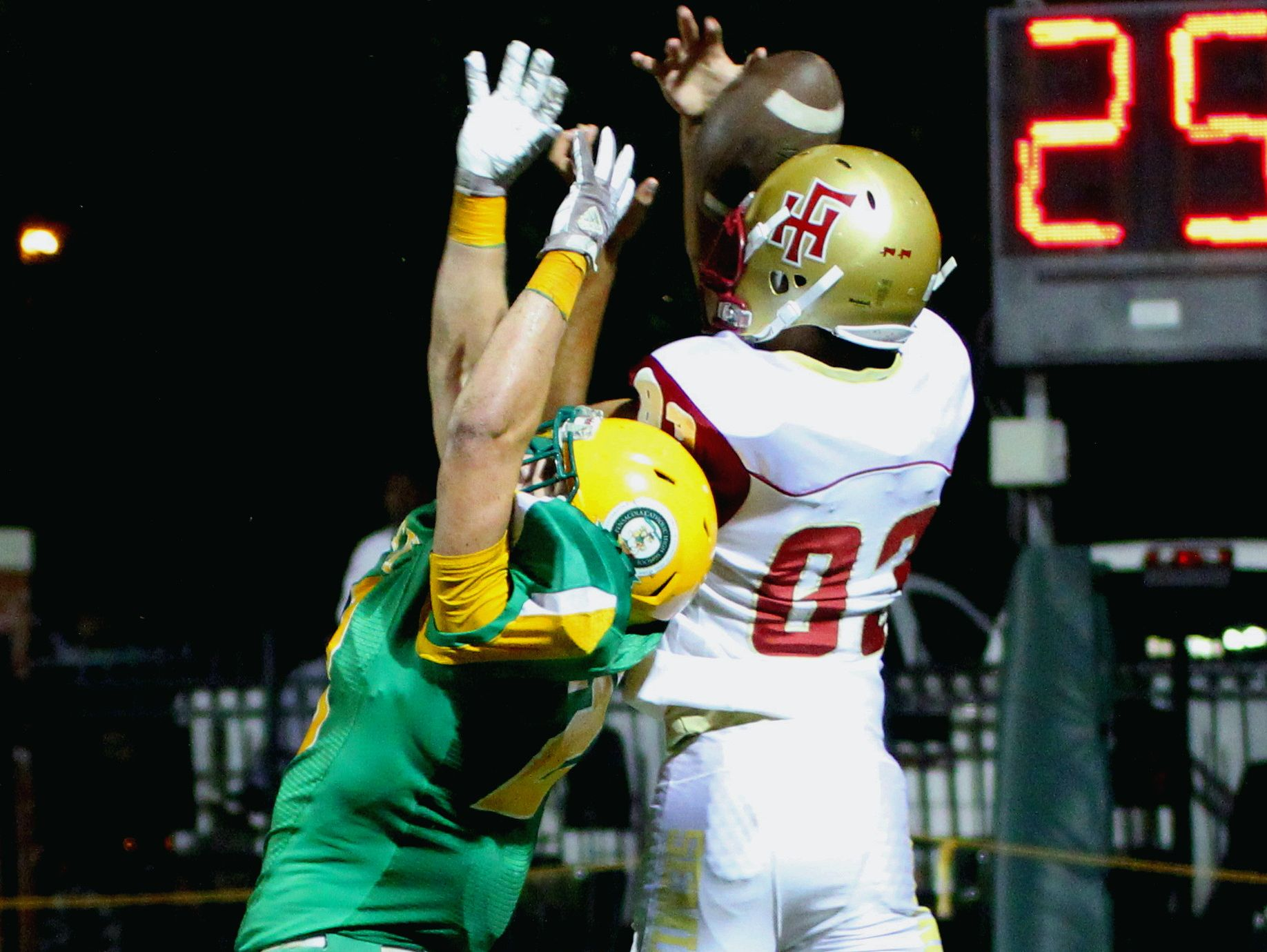 Florida High's Jordan Alexander (83) gets a hand on a pass but couldn't hang on in second half action. Catholic's Collin Acromite (20) defended on the play.