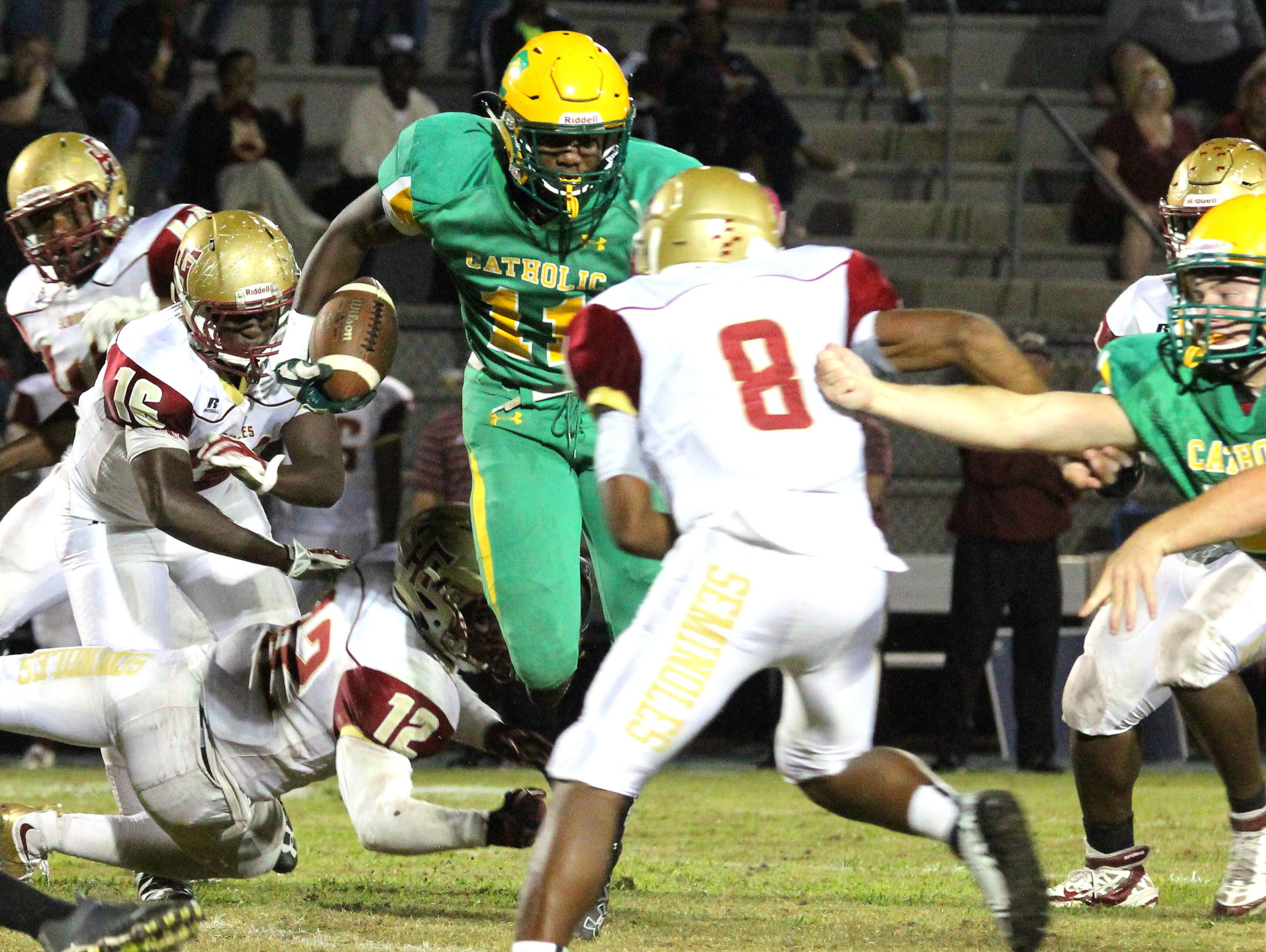 Catholic's Kerrick Teamer carries the ball in the second half.