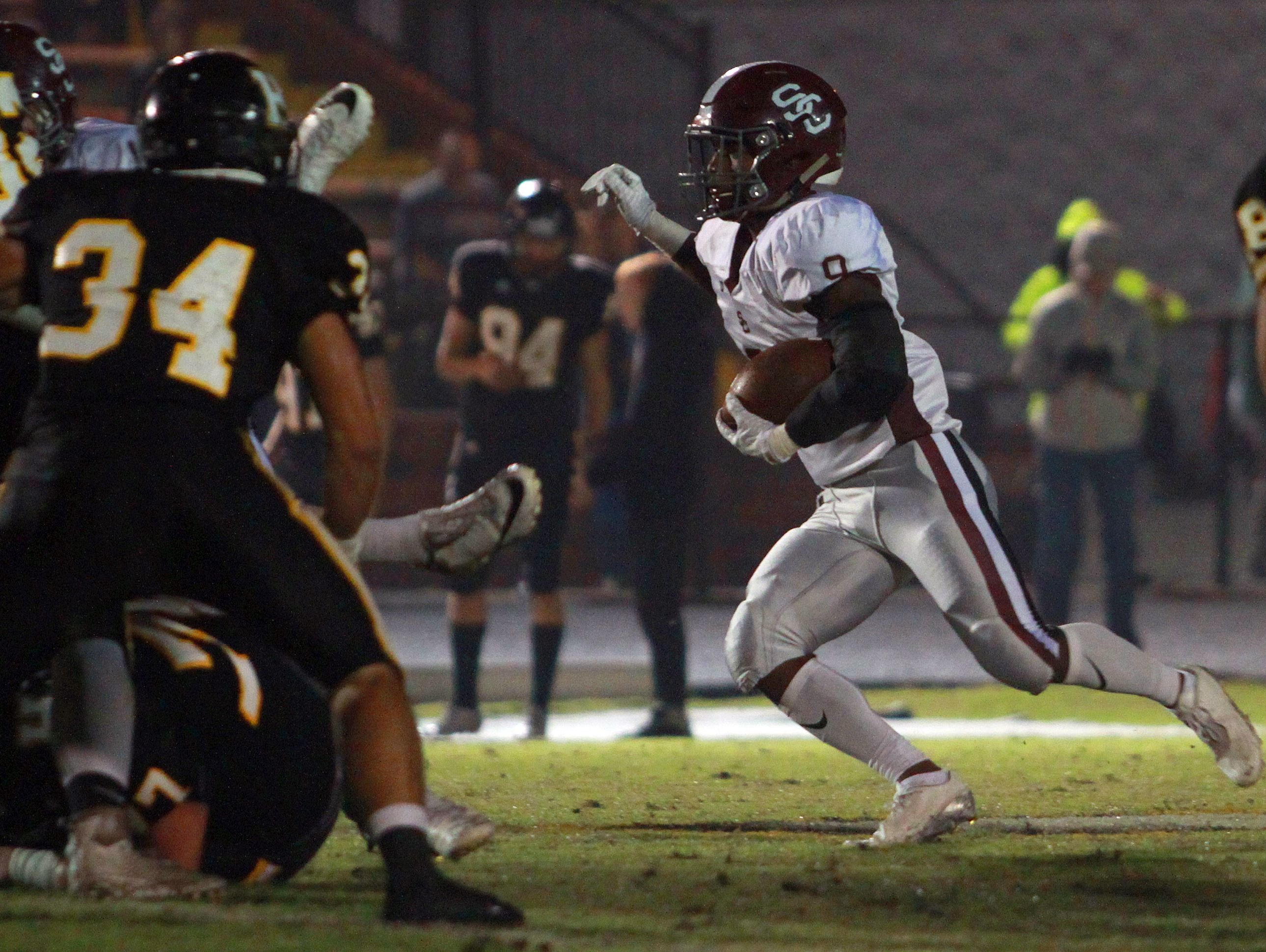 Station Camp's Sirtavious Perry rushes against Hendersonville during Friday's game.