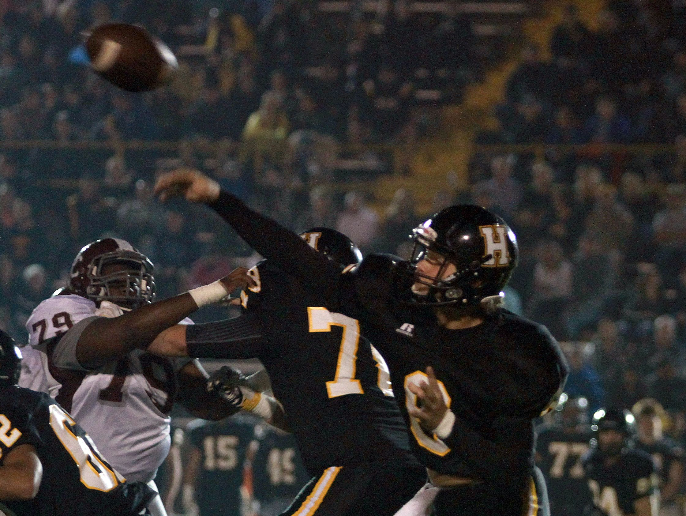 Hendersonville QB Brett Coker fires a completion during Friday's game against Station Camp.