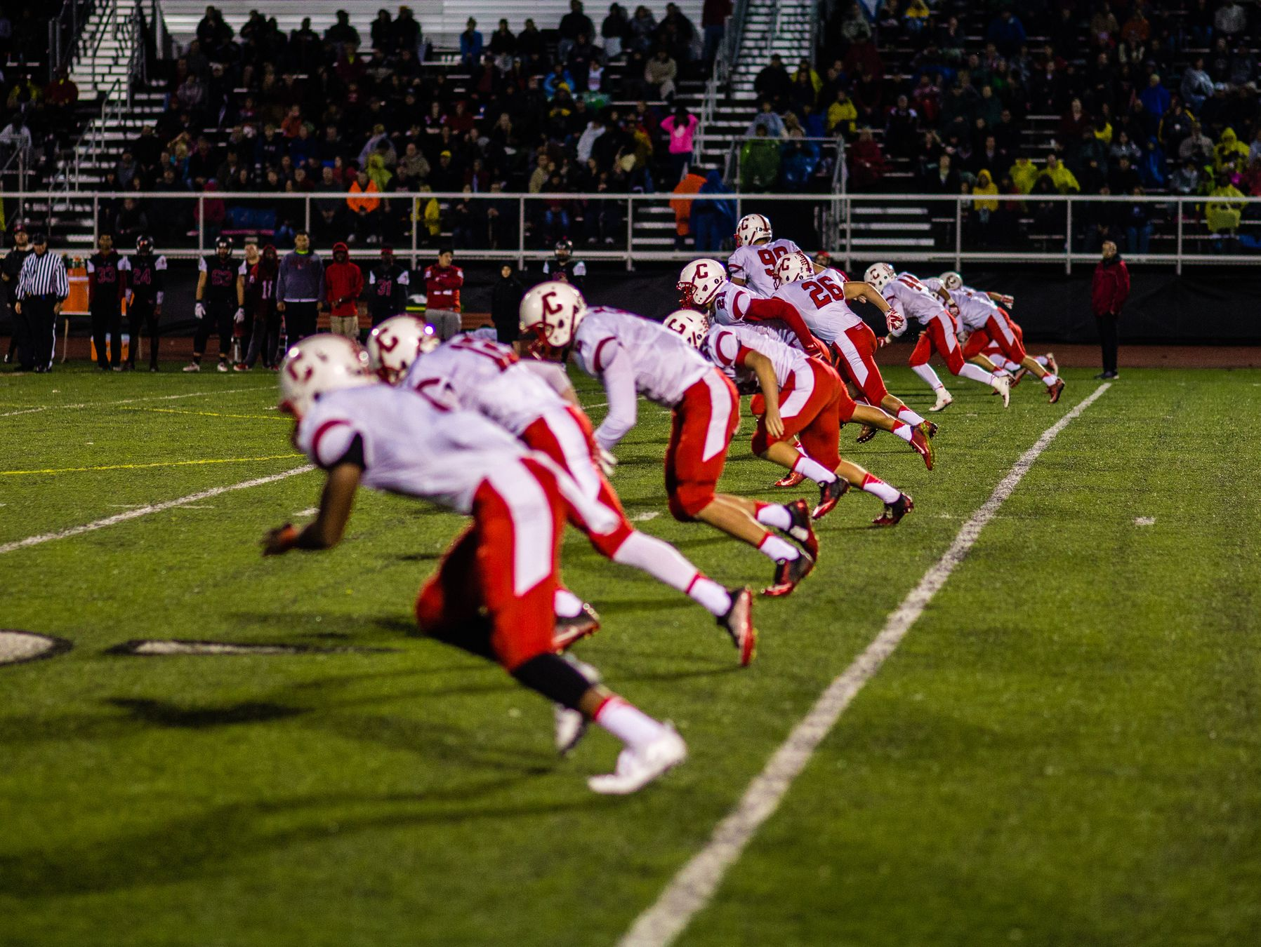 The Canton high school offensive line chases a kickoff during a game against Livonia Churchill on Friday.