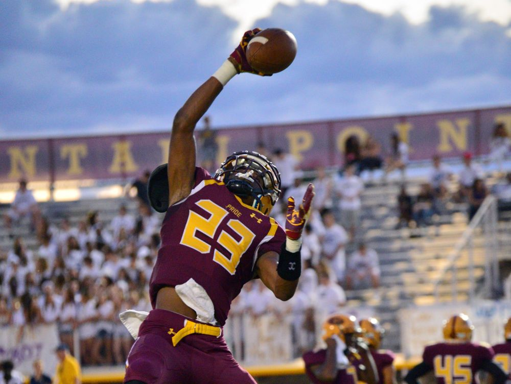 Mountain Pointe wide receiver Kenny Churchwell makes a one-handed catch during warmup before the game against Desert Vista Desert Vista quarterback Nick Thomas runs the ball upfield against Mountain Pointe on Friday, Sept. 30, 2016.