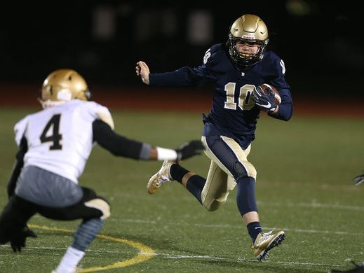 Brighton quarterback Shea McDonald, shown here trying to elude Greece Athena safety Kenny Speed (4), helped the Barons win the team's first Monroe County division title since 1999.