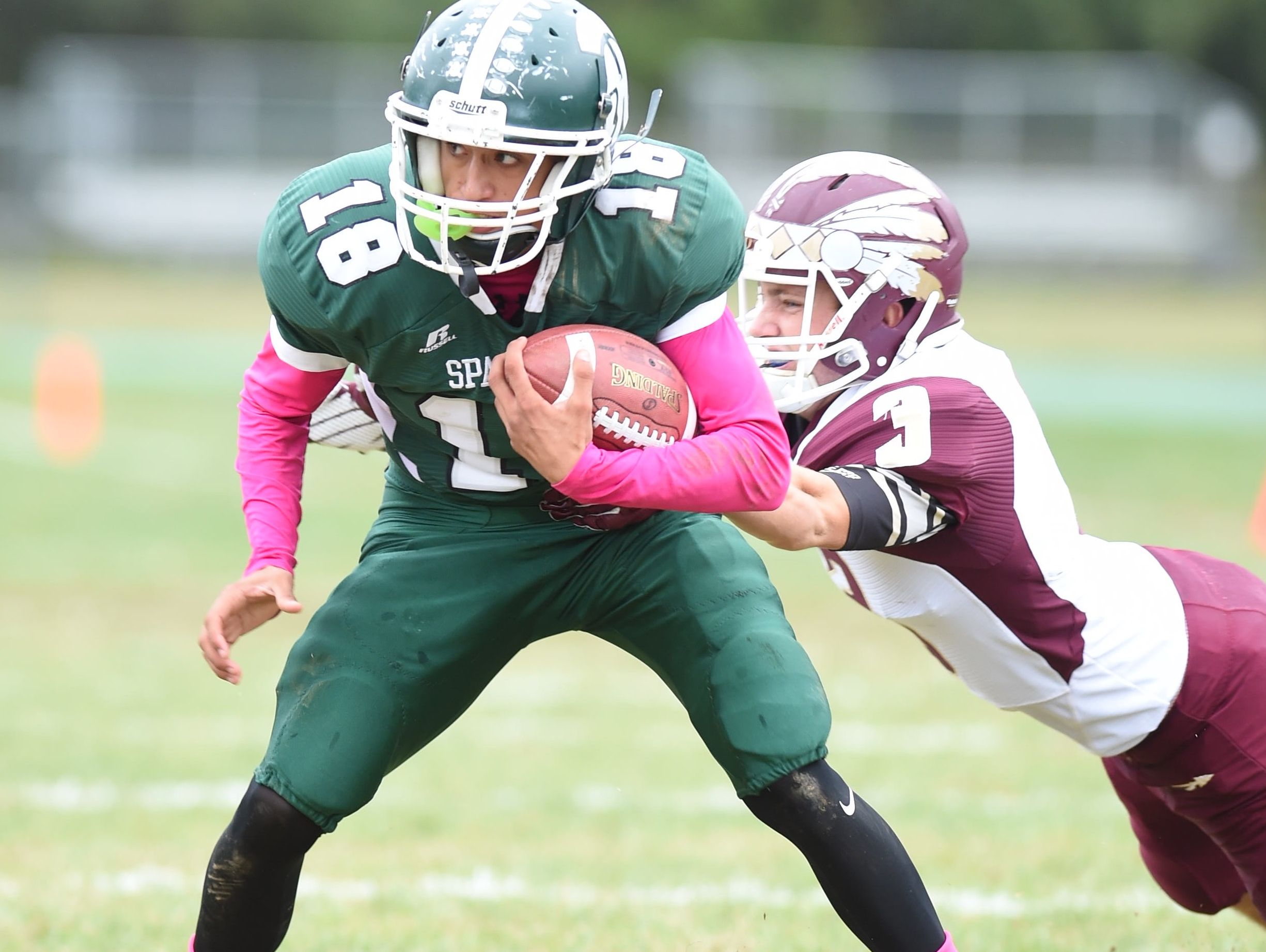 Spackenkill's Marlon Brooks attempts to shake off O'Neill's Tully Boylan during Saturday's game at Spackenkill.